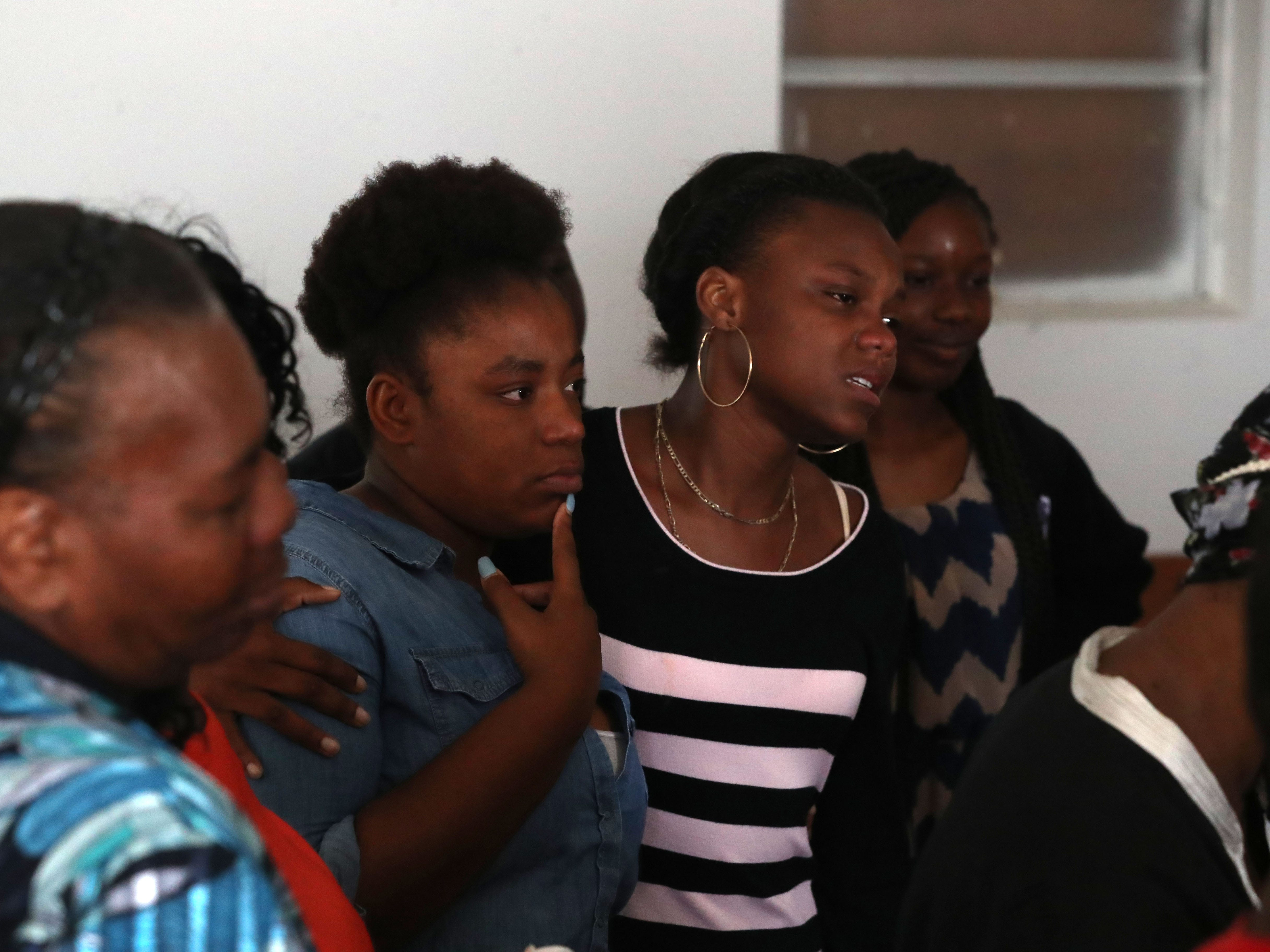 Many friends and family members of Demashell Bass, a woman who could not receive medical attention and died during the hurricane, mourn her loss at the Dream, Vision, and Destiny (DVD) Ministry in Gretna, Fla., on Sunday Oct. 14, 2018, after Hurricane Michael hits the Florida panhandle.