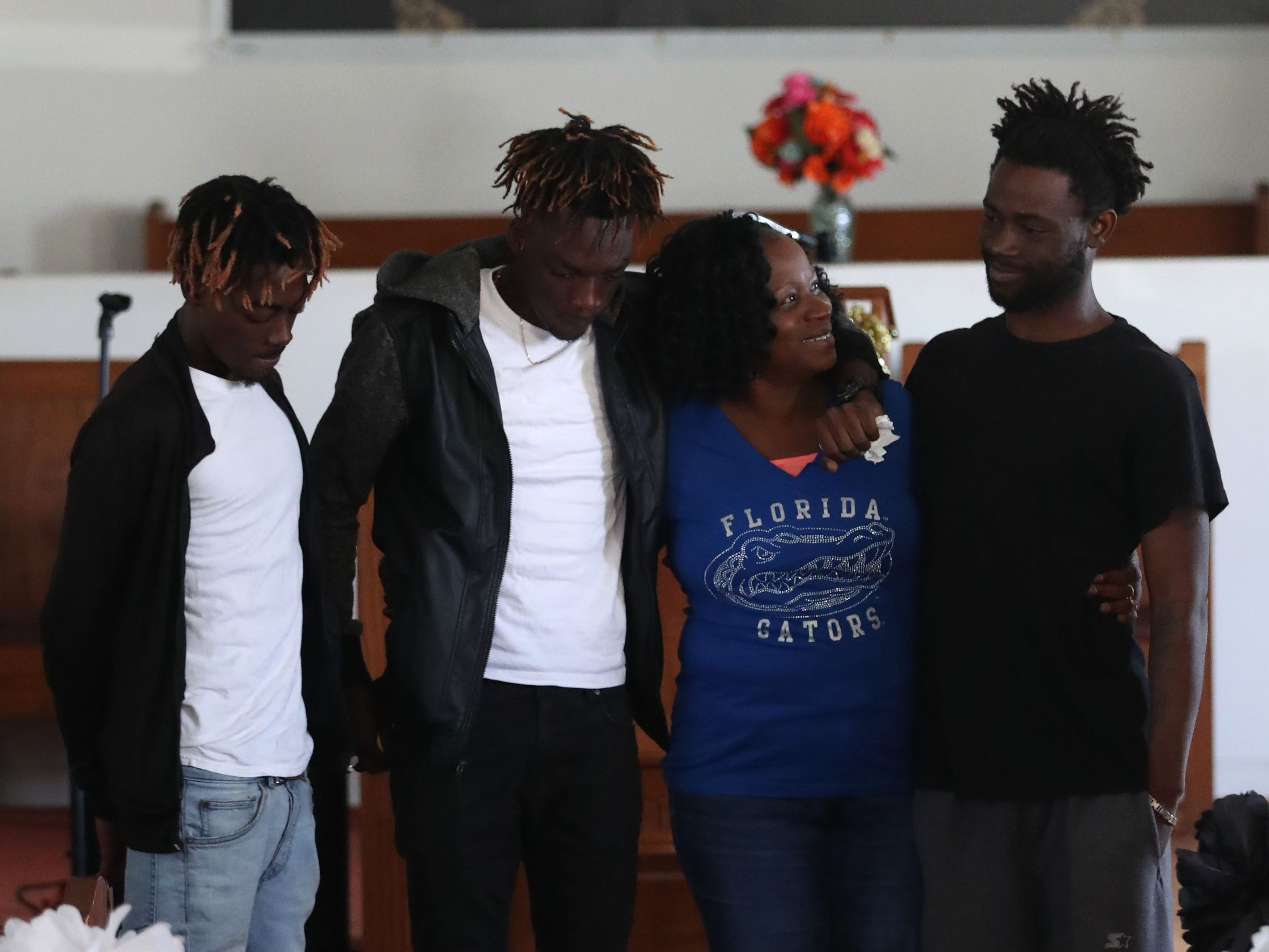 The family of Demashell Bass, a woman who could not receive medical attention and died during the hurricane from left to right, Tyran Grant, son, 21, Tyrone Grant, son, 23, Isabella Dubose, aunt, 54, and Lawrence Williams, brother, 33, at the Dream, Vision, and Destiny (DVD) Ministry in Gretna, Fla., on Sunday Oct. 14, 2018, after Hurricane Michael hits the Florida panhandle.