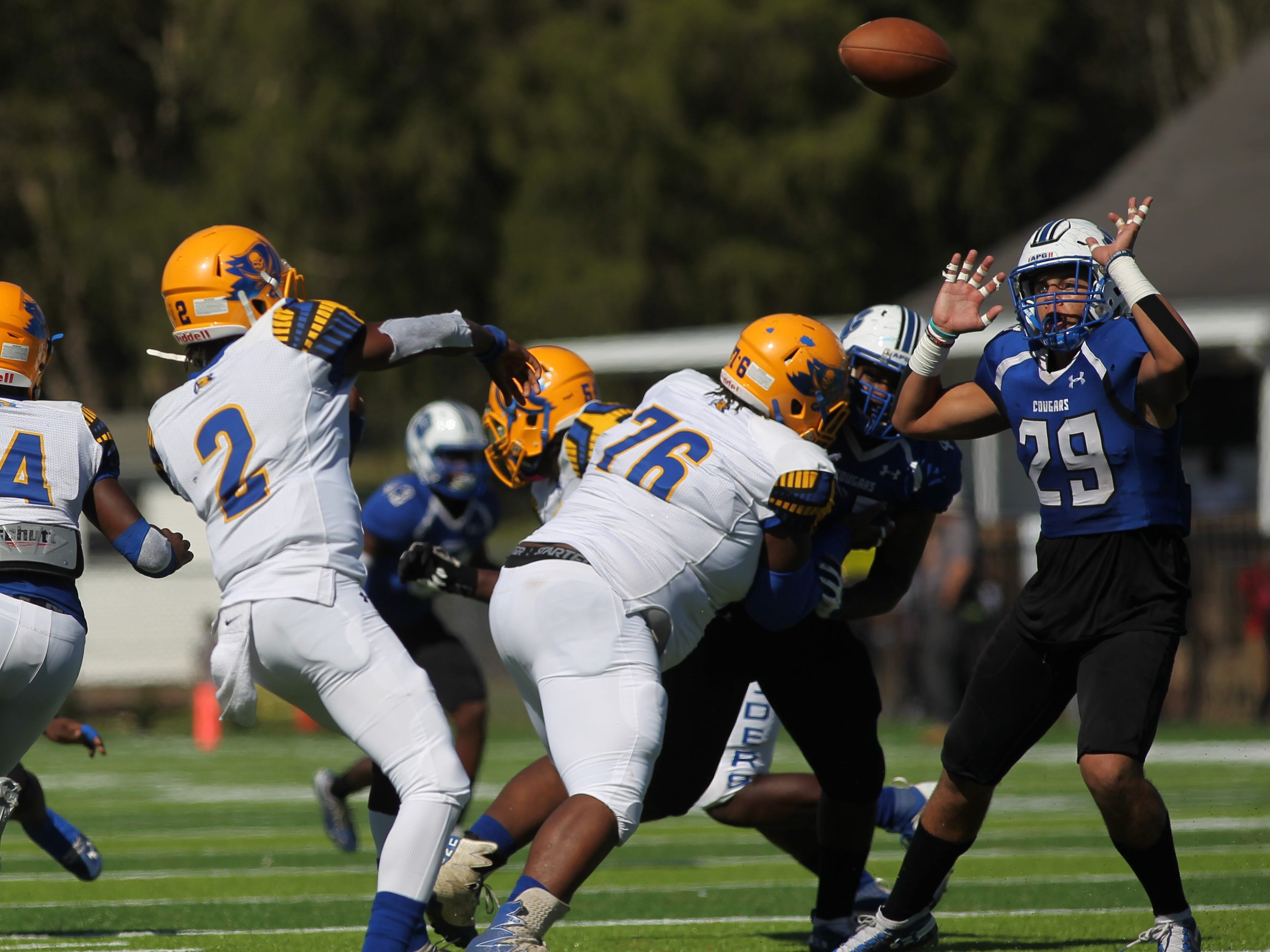Rickards quarterback D'eryk Pete throws a pass against Godby that Kyler Laing tries to get his hands up to knock down.