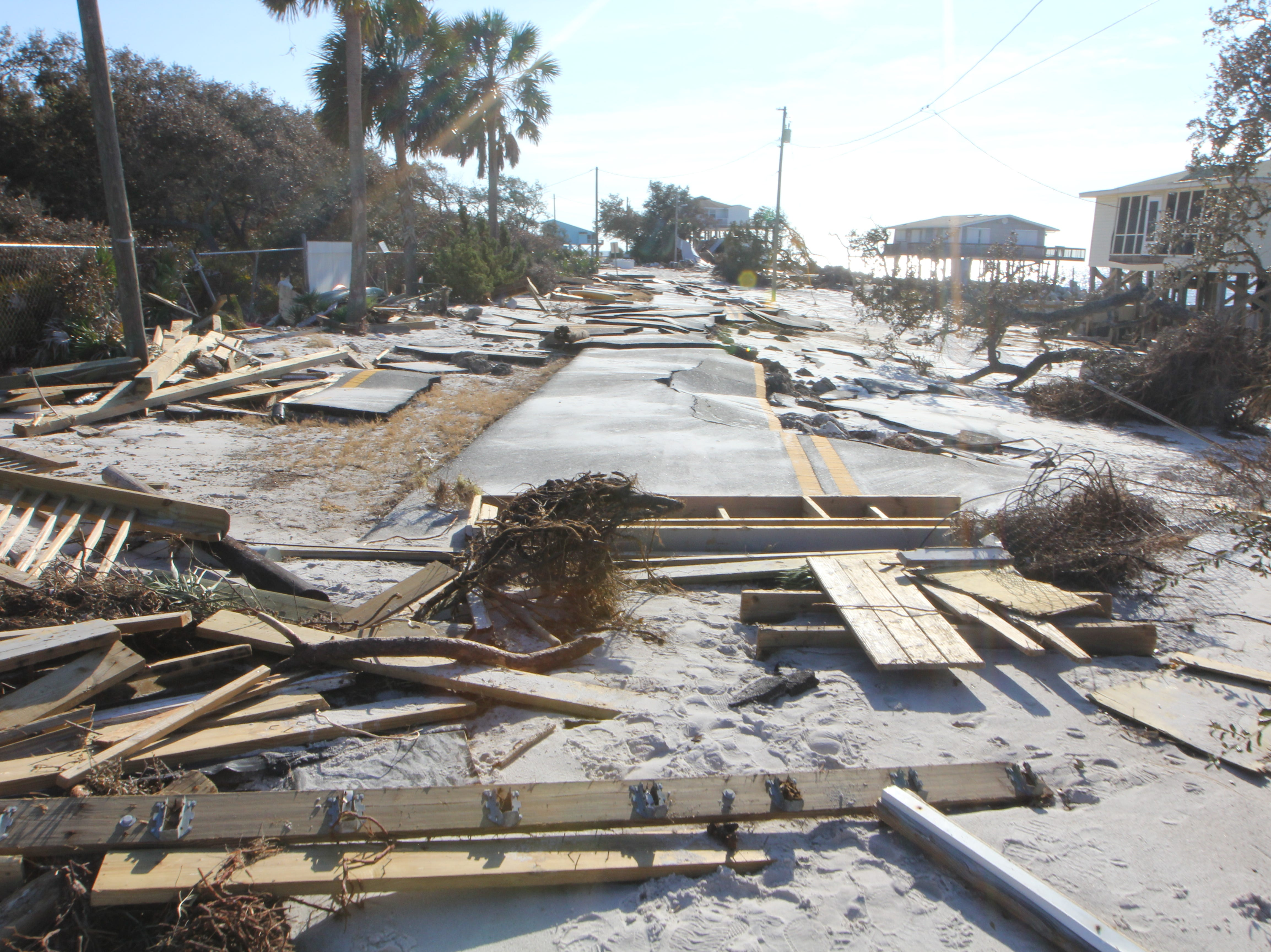 Wood and other rubble litters the roadway on Alligator Point. Hurricane Michael has left the isolated peninsula nearly cut off after the main road washed away.