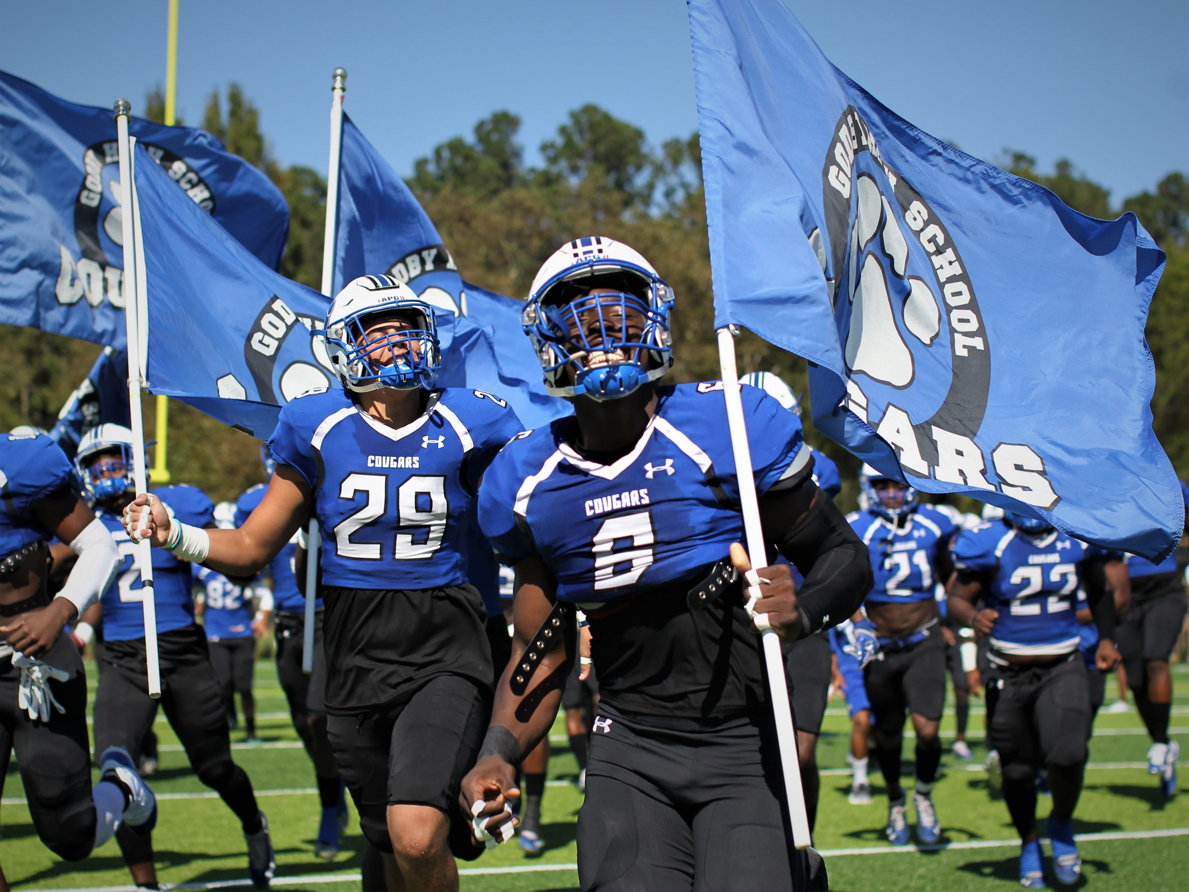 Godby's Kyler Laing (29) and Javon Solomon (6) get hyped before playing Rickards.
