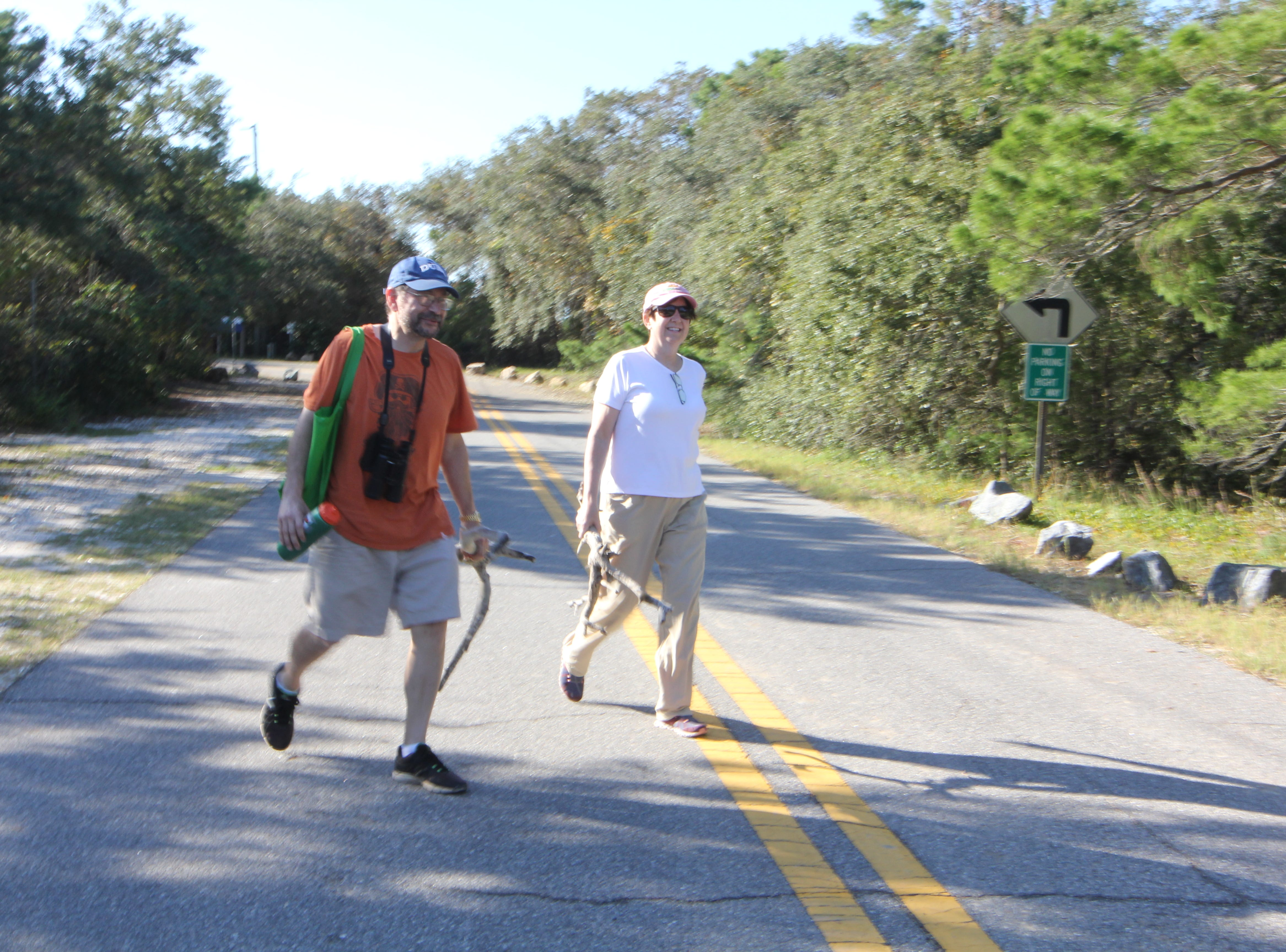Jennifer LaVia and Jay LaVia wal to their house on Alligator Point. Hurricane Michael washed away the main road making access to the peninsula tough.