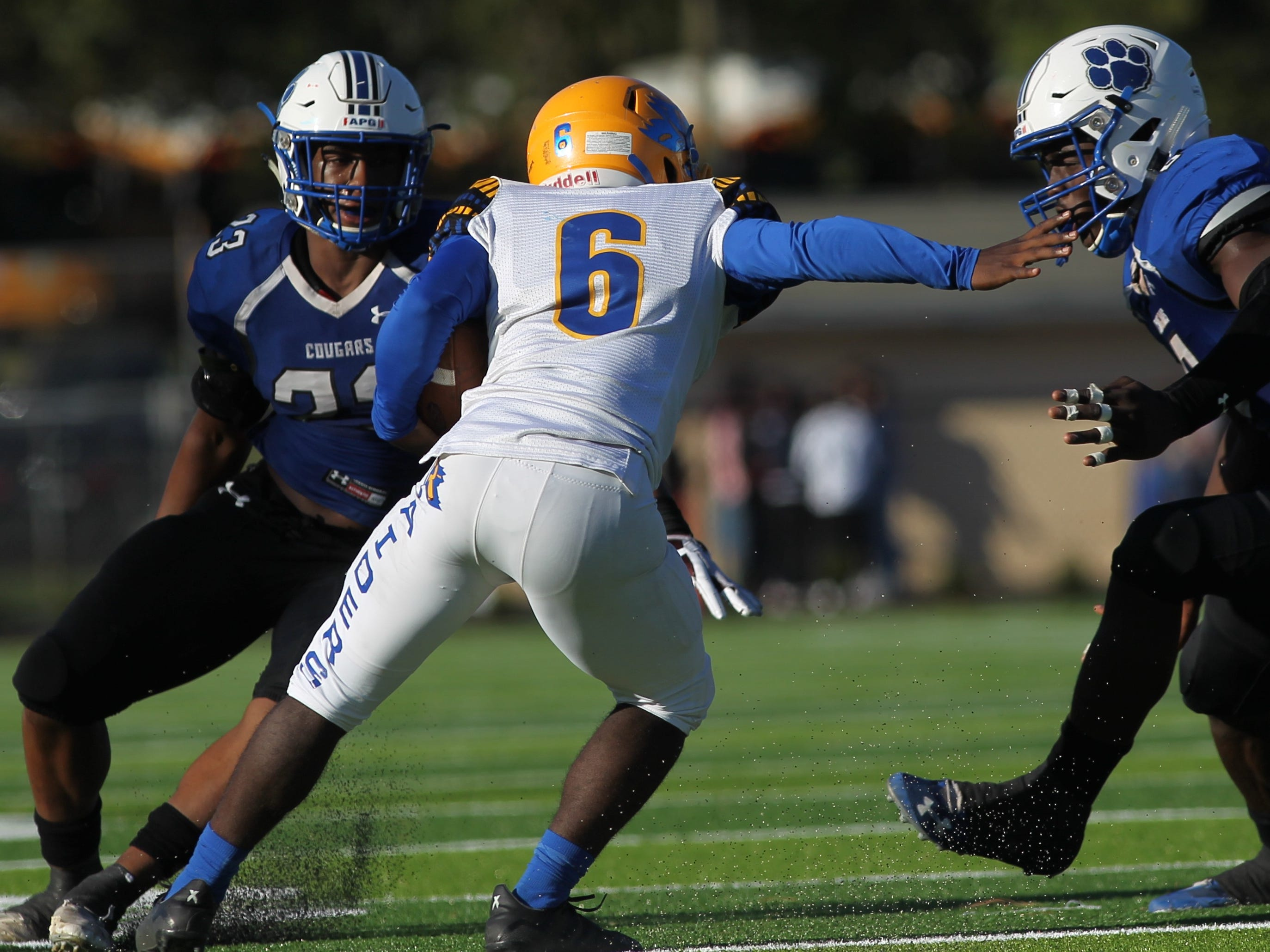 Rickards running back De'andre Francis tries to escape Godby tacklers.