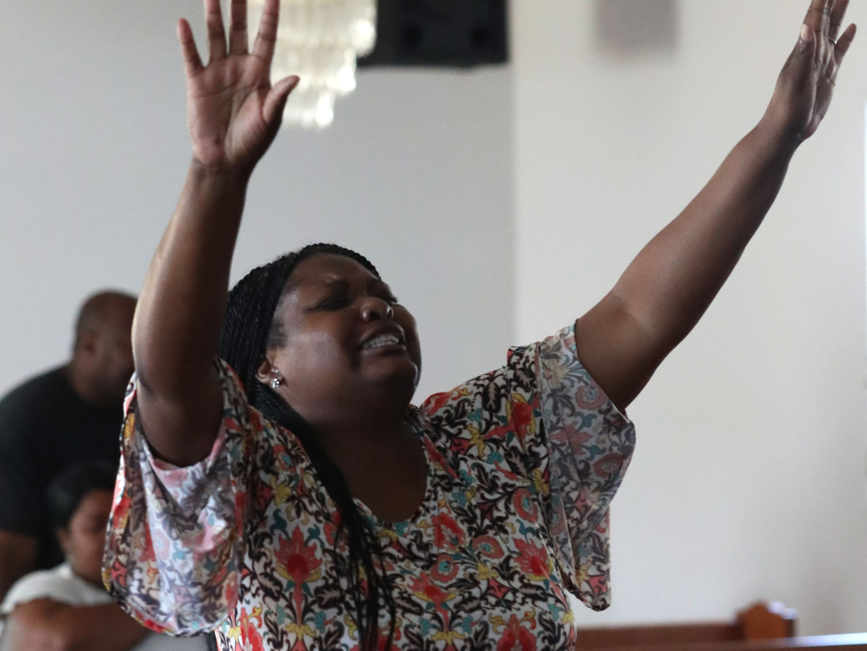 Delisha Green, member of the Dream, Vision, and Destiny (DVD) Ministry in Gretna, Fla. sings her praises at Sunday service on Oct. 14, 2018, after Hurricane Michael hits the Florida panhandle.