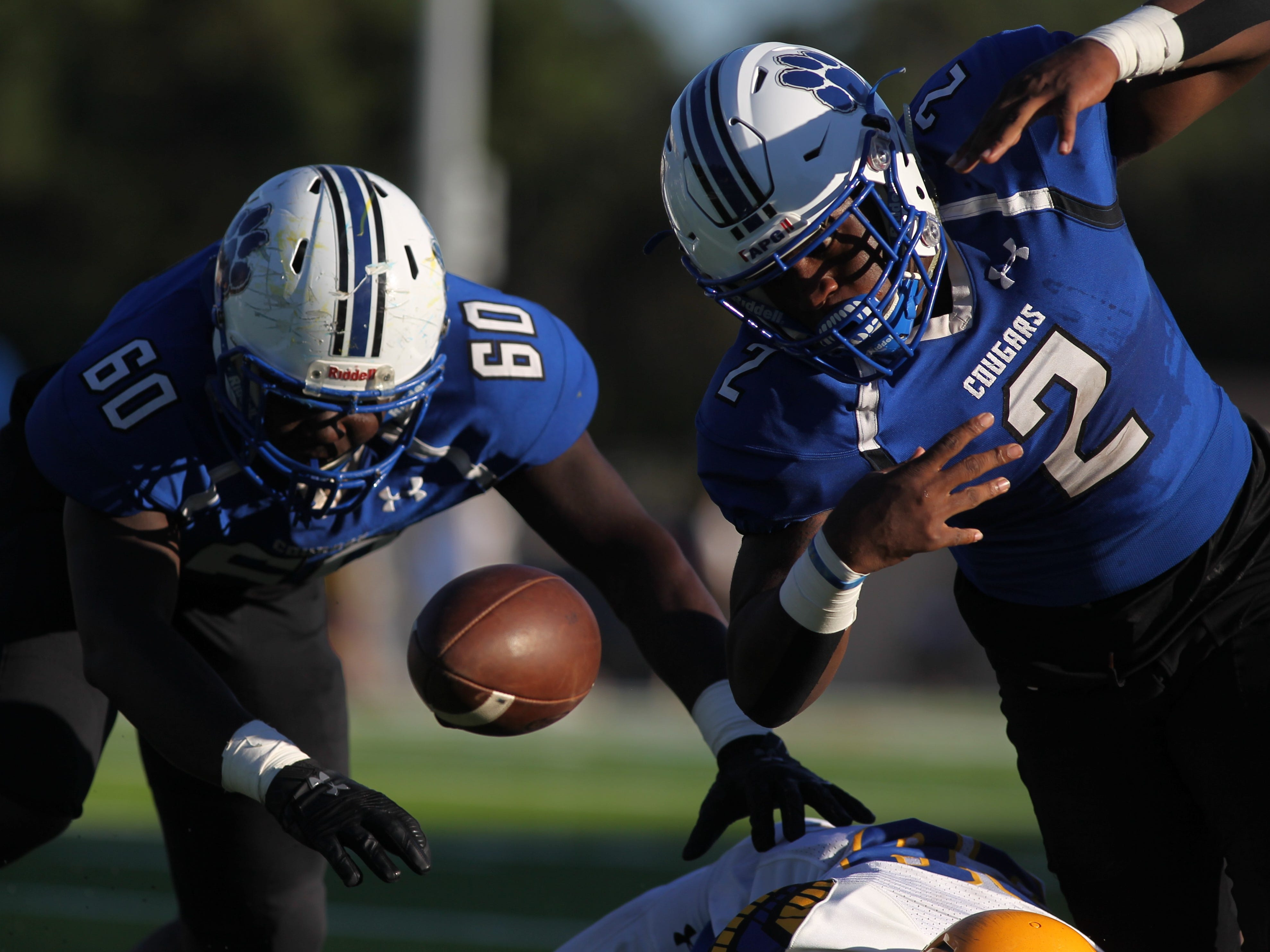Godby running back Tony Street runs upfield but is hit and fumbles during Saturday's game against Rickards.