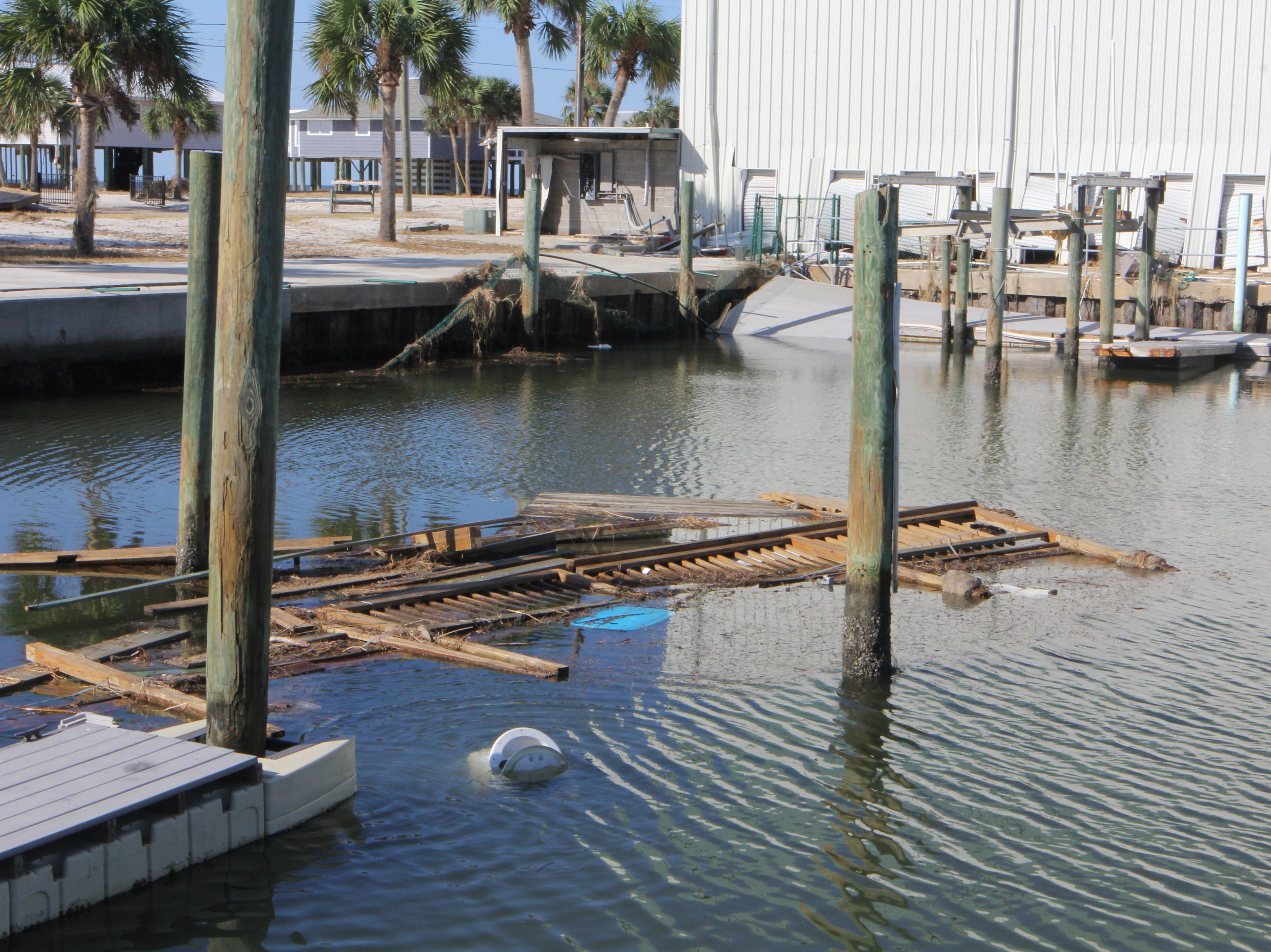 Debris floats in Alligator Point Marina after Hurricane Michael.