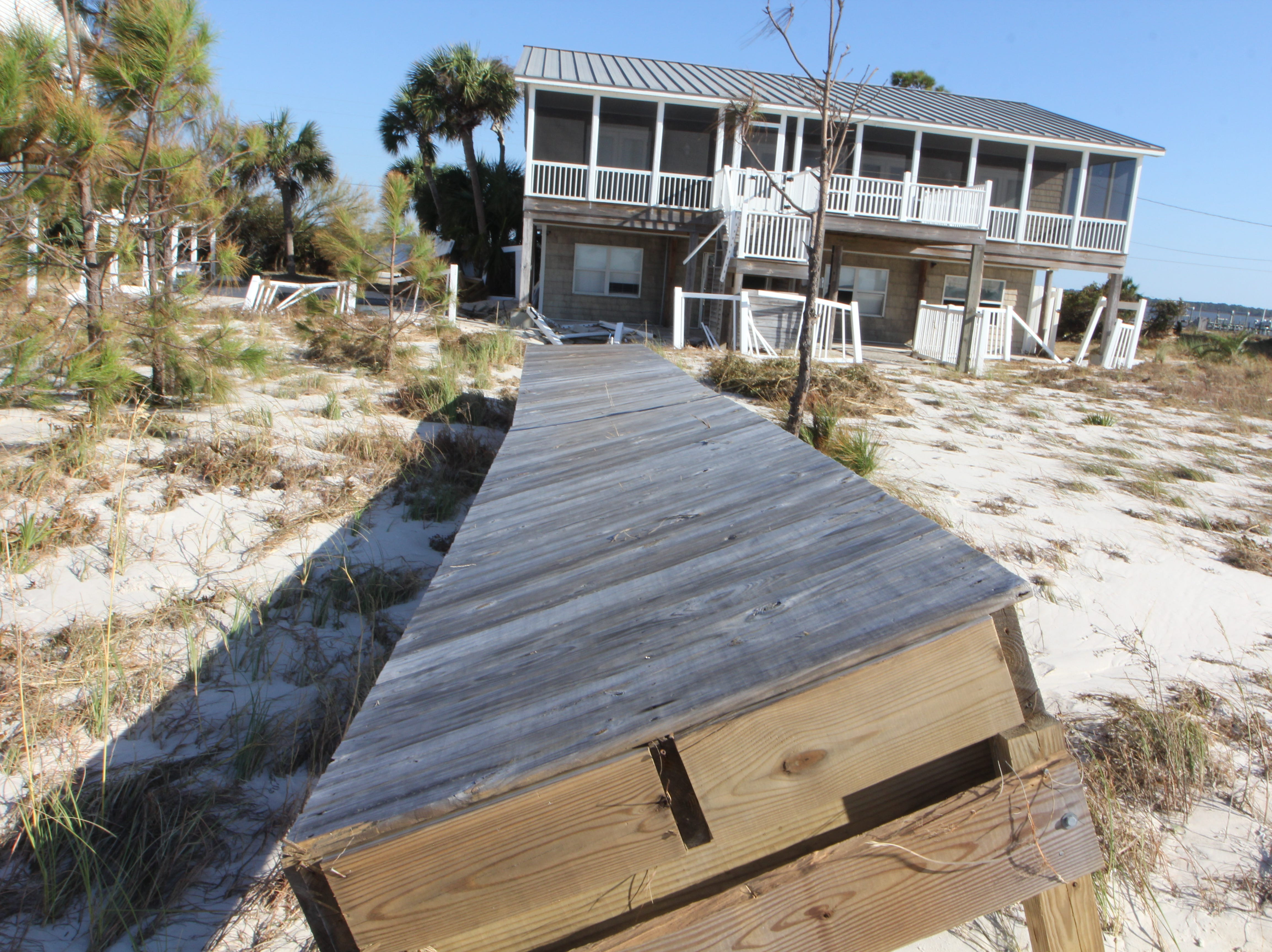 A dock that once led to a house on Alligator Point sits in shambles after Hurricane Michael.