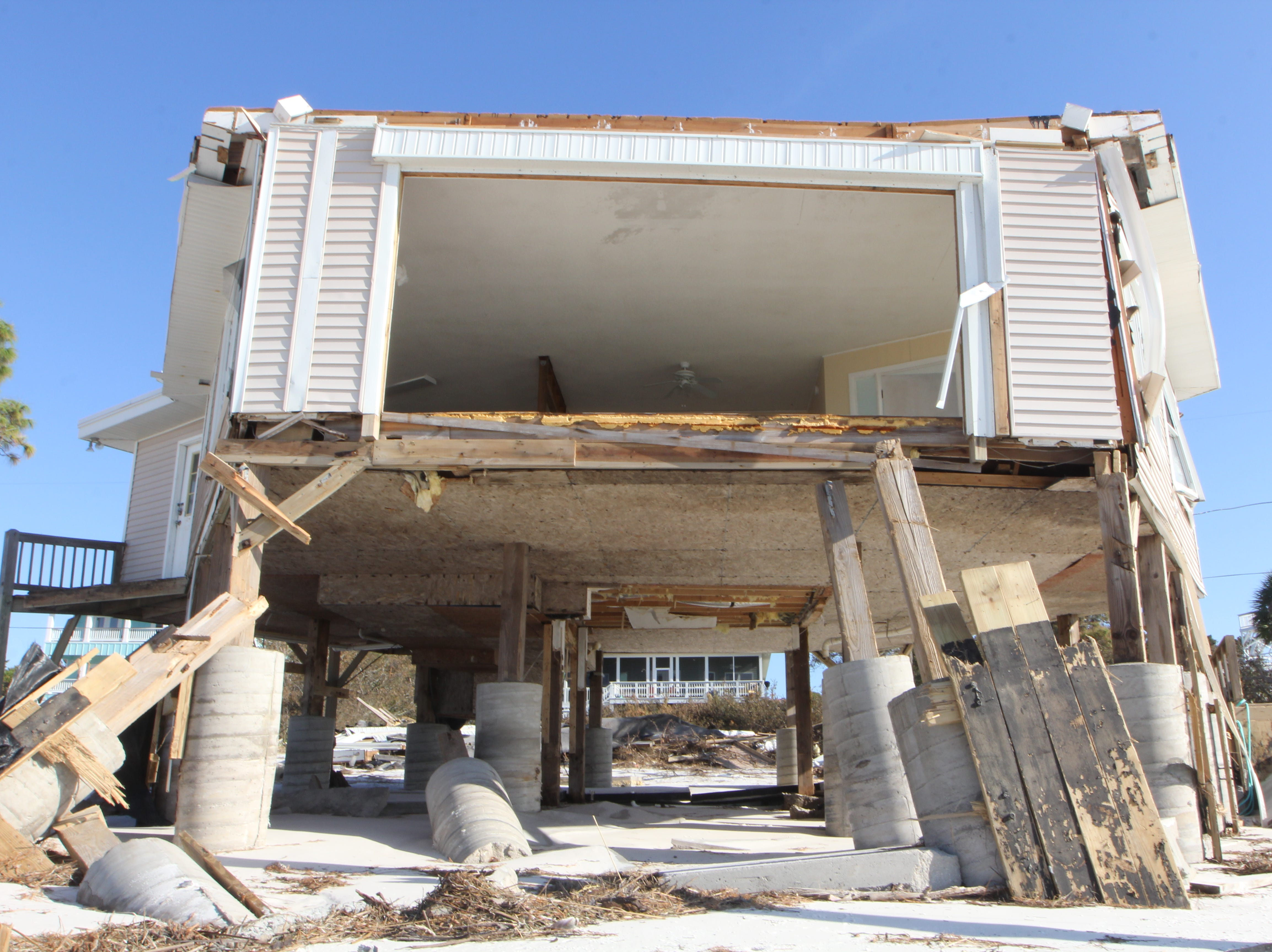 The front of a house is exposed to the sea after being ripped apart by Hurricane Michael