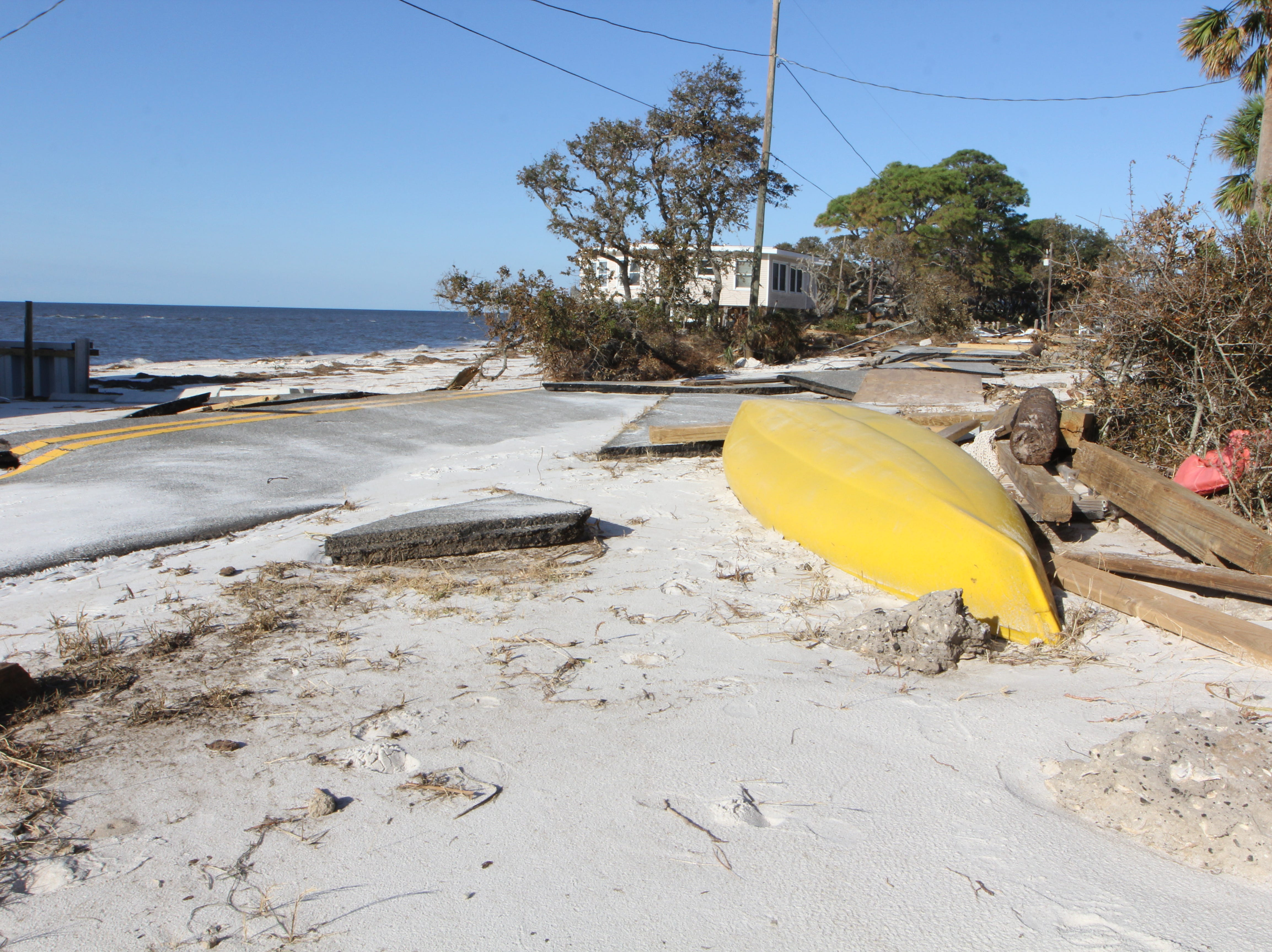 A kayak sits among rubble on Alligator Point after Hurricane Michael
