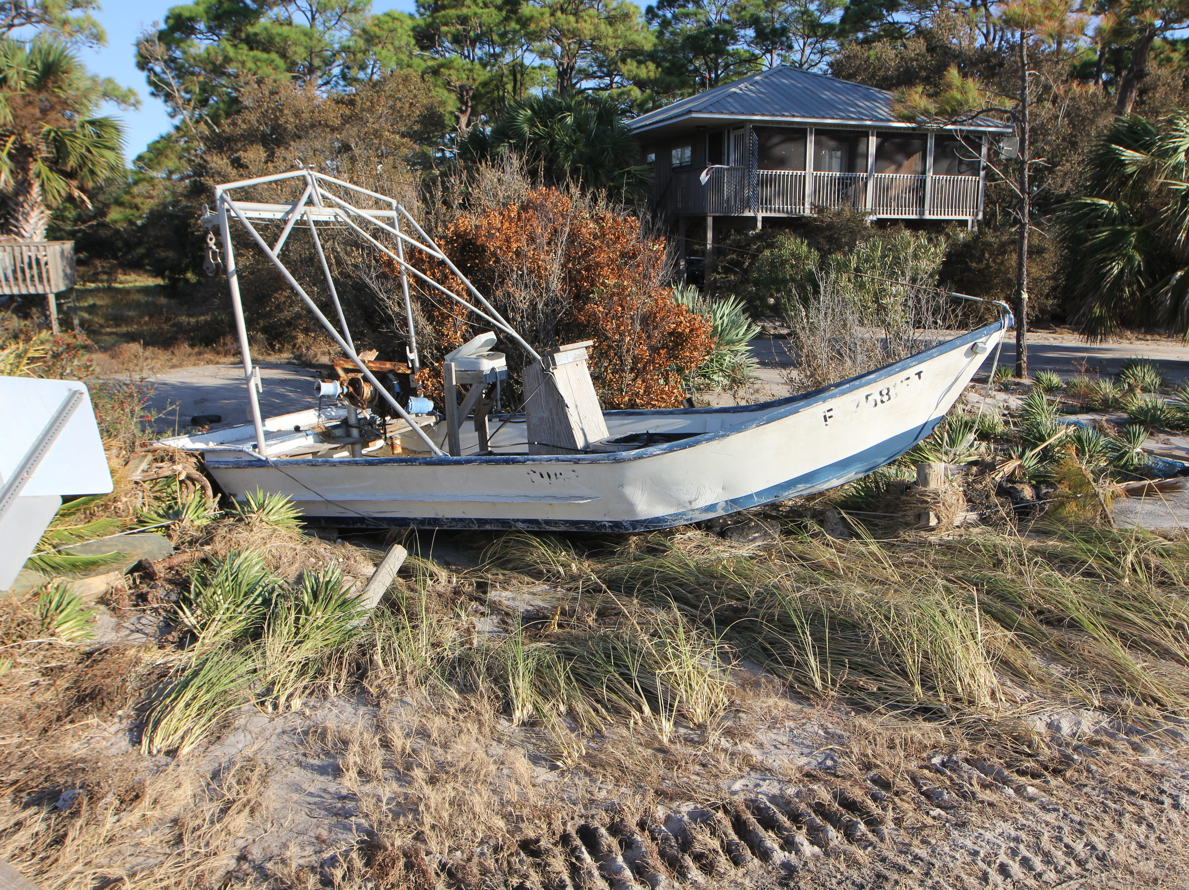 A boat lays among other debris on the main road to Alligator Point. The roadway was washed out after Hurricane Michael.