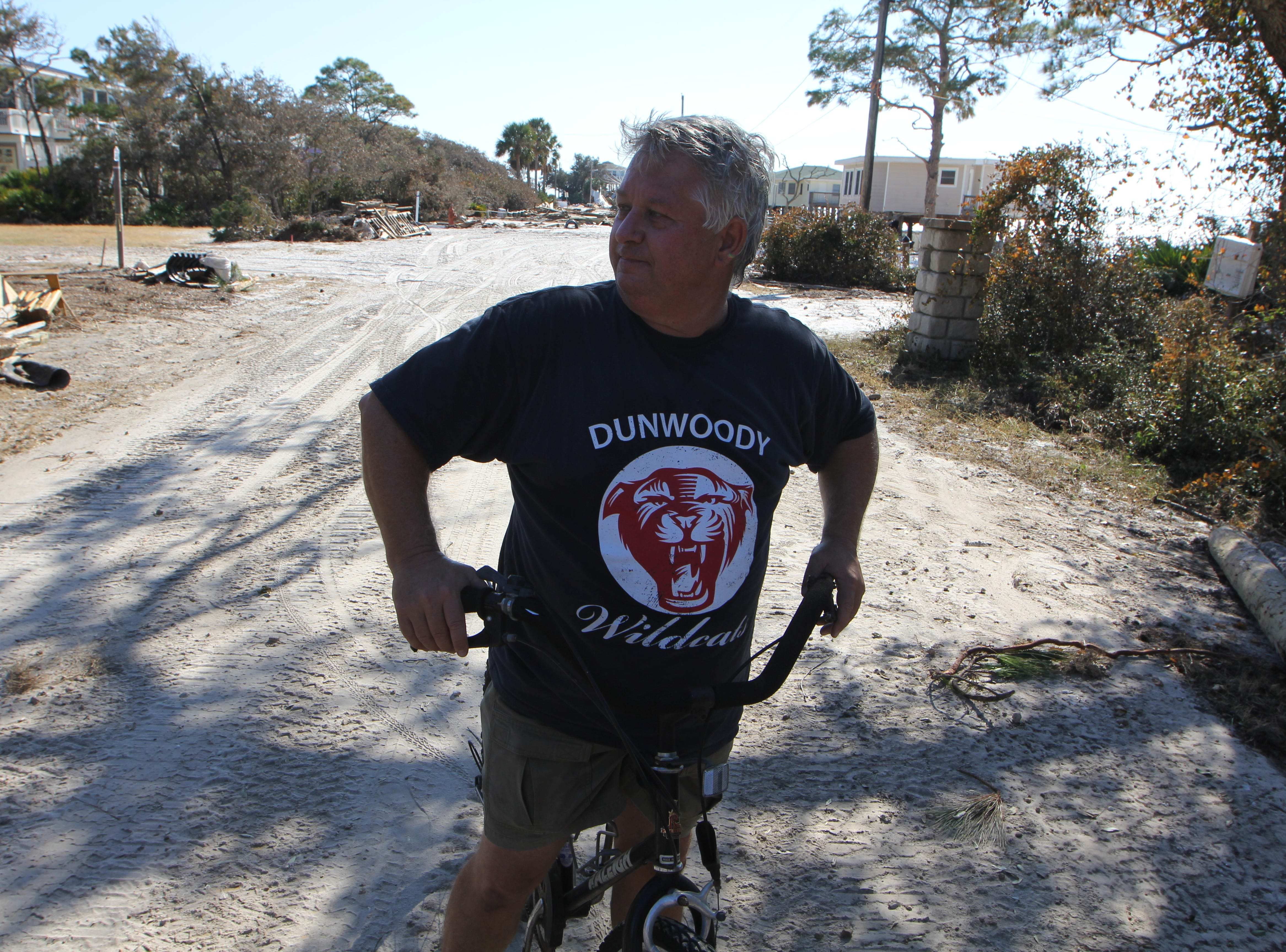 Brett Hensley surveys damage on Alligator Point after Hurricane Michael. The storm washed out a major portion of the main road making accessibility an issue.
