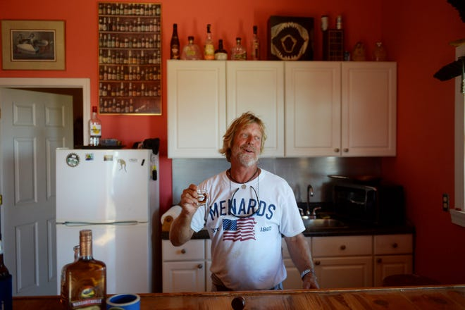 """Oct. 13, 2018, Port St. Joe, FL, USA; """"Hey, I've been through this before and I'm going to be just alright,"""" said Port St. Joe resident Dave Russell, who decided to stay in his home through Hurricane Michael. Russell's home suffered two holes in the roof and external damage. Most homes weren't so lucky as Port St. Joe and neighboring community Mexico Beach suffered some of the most catastrophic damage from the storm. Mandatory Credit: Patrick Dove/Treasure Coast News via USA TODAY NETWORK"""