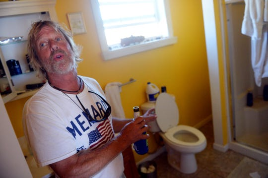 "Oct. 13, 2018, Port St. Joe, FL, USA; Dave Russell talks about hiding out in his bathroom during the worst of Hurricane Michael in his Port St. Joe residence. ""Ive been through bad storms before but it got spooky there for a while so I put on an old motorcycle helmet for protection,"" Russell said. Mandatory Credit: Patrick Dove/Treasure Coast News via USA TODAY NETWORK"