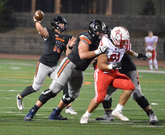 Ventura College quarterback Brock Domann throws a pass during the Pirates 23-10 win over visiting Bakersfield College on Saturday night at the VC Sportplex.