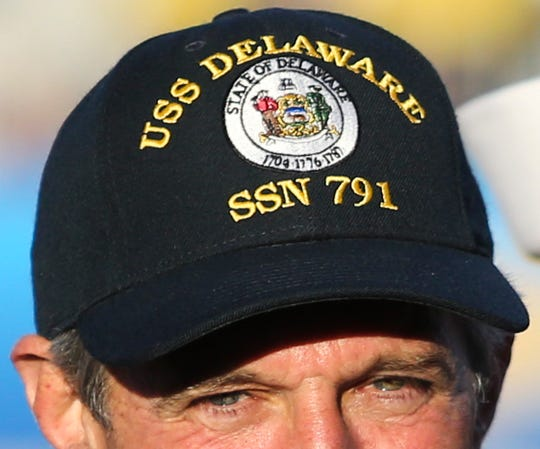 Delaware governor John Carney wears a hat touting the soon-to-be Navy's newest vessel, the USS Delaware submarine in the second half of the Blue Hens' 28-16 win at Delaware Stadium Saturday. Carney was with crew members of the vessel which is to be christened Oct. 20. in Virginia.