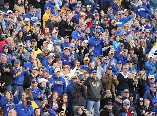 Blue Hens fans cheer as Delaware closes out their 28-16 win against Elon University at Delaware Stadium Saturday.