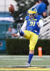 Nick Pritchard punts the football for Delaware.