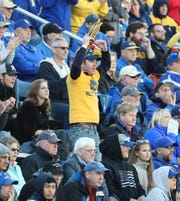 """""""Trumpet Man"""" (aka Matt Delaney) cheers on his team in the fourth quarter of the Blue Hens' 28-16 win at Delaware Stadium Saturday."""