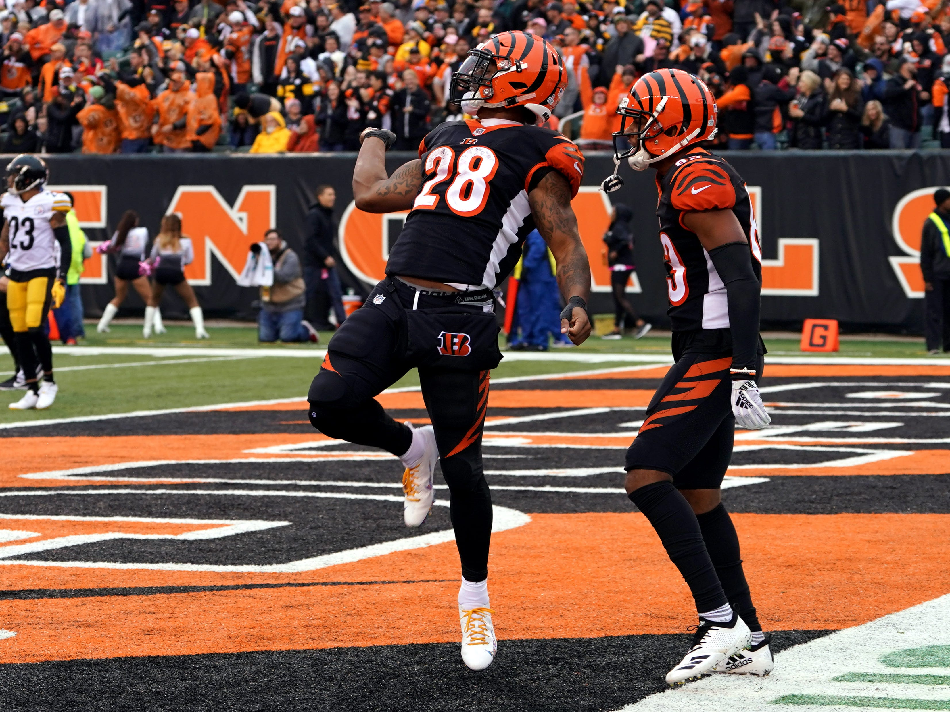 Cincinnati Bengals running back Joe Mixon reacts to scoring a touchdown with wide receiver Tyler Boyd (right) against the Pittsburgh Steelers in the second half at Paul Brown Stadium.