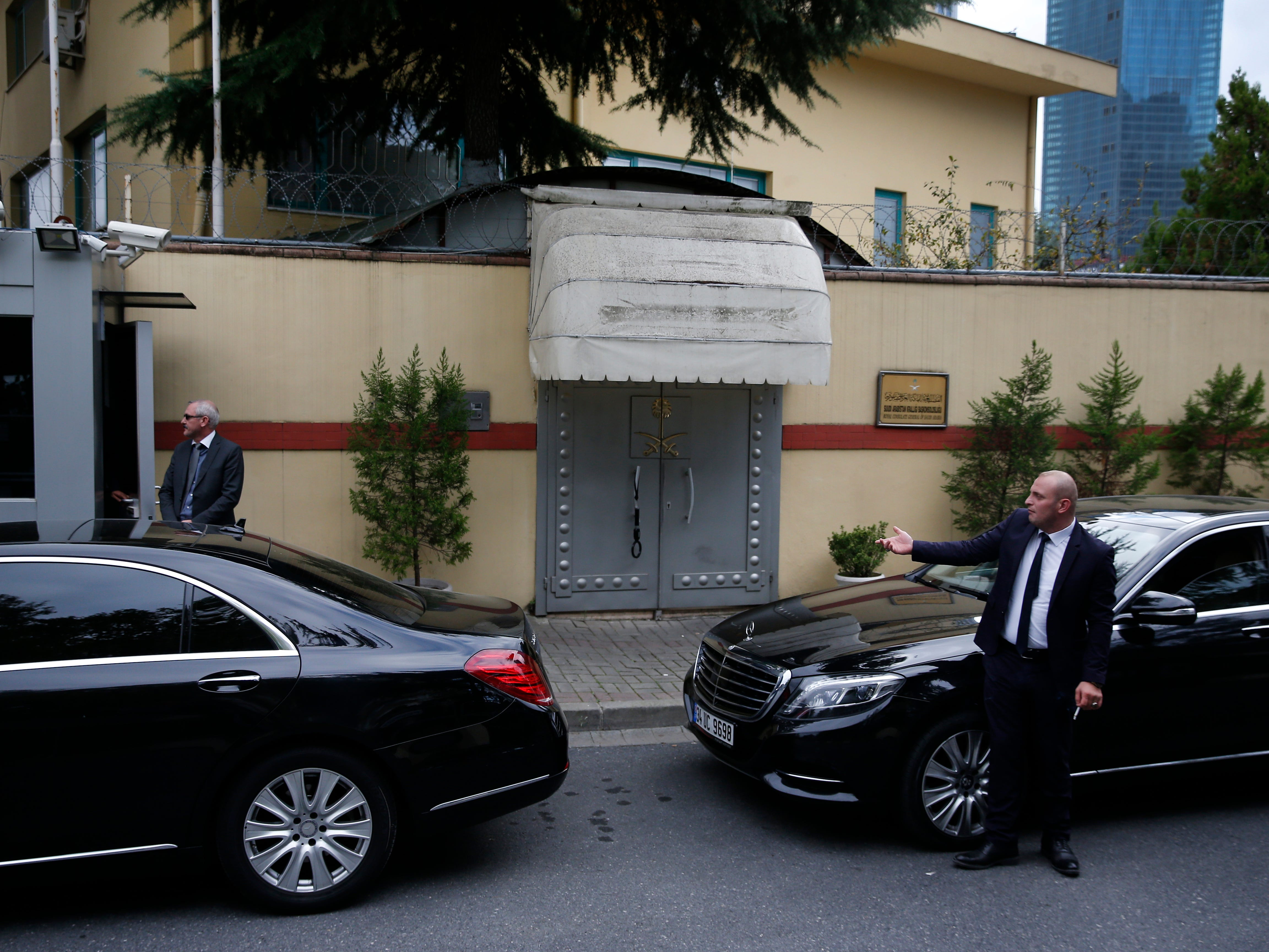 Security guards stand outside the Saudi Arabia's consulate in Istanbul, Tuesday, Oct. 9, 2018.