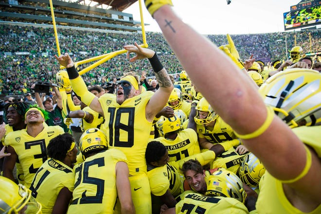 The Oregon Ducks celebrate in the end zone after a game against Washington Huskies at Autzen Stadium.
