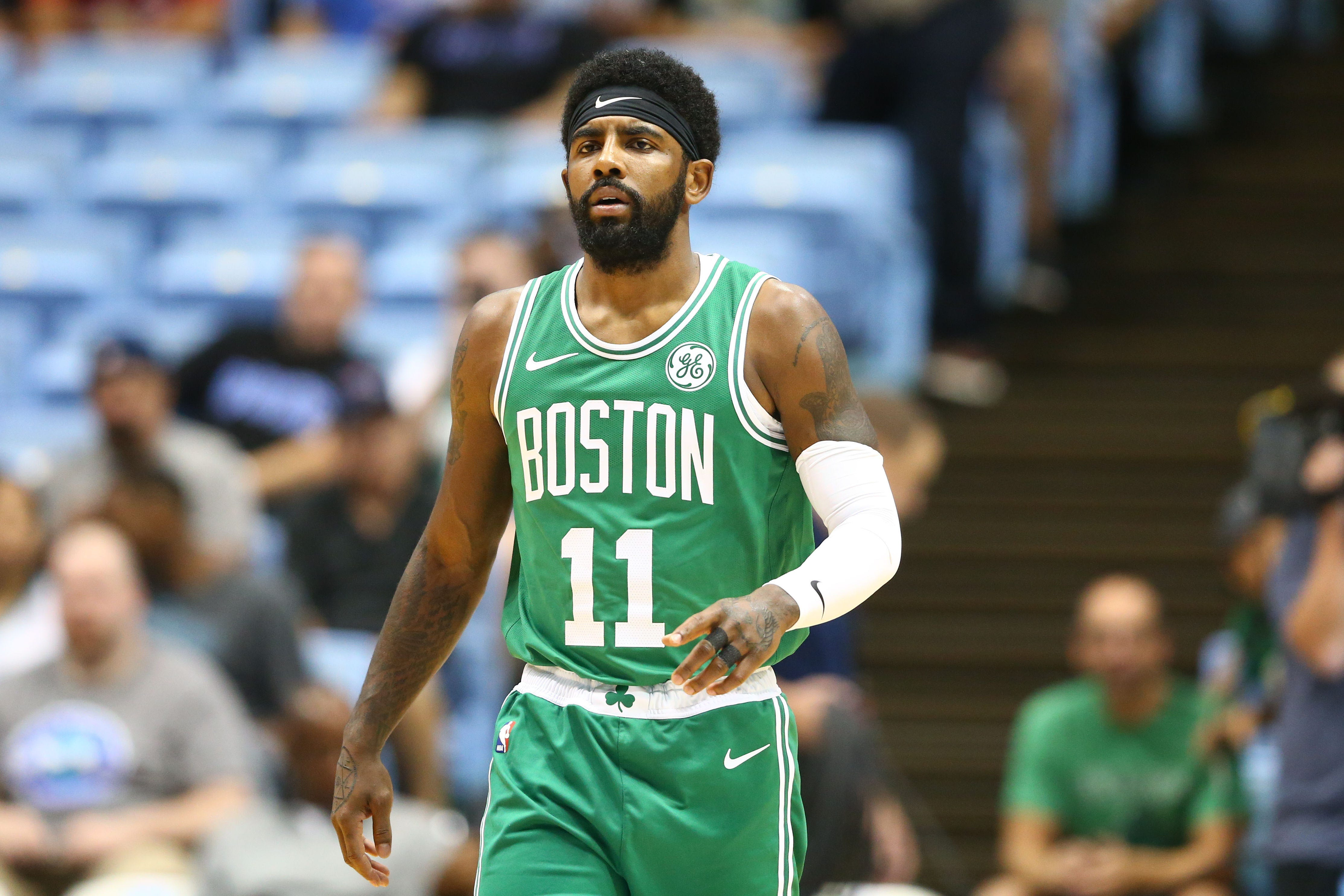 Boston Celtics guard Kyrie Irving walks down the court in the first half against the Charlotte Hornets at Dean E. Smith Center.