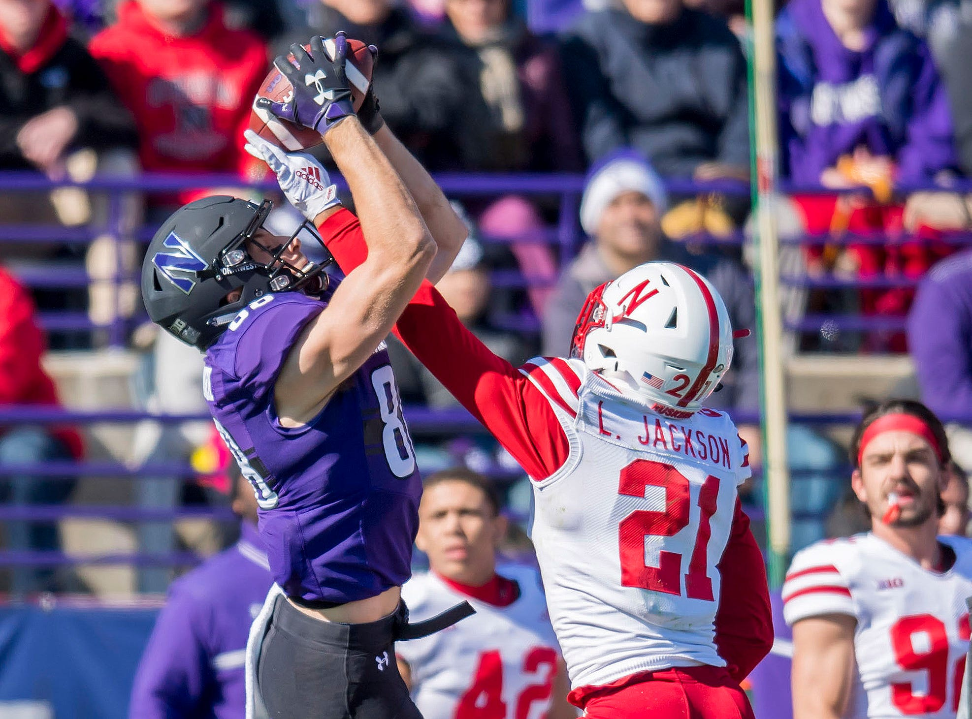 Nebraska Cornhuskers defensive back Lamar Jackson (21) breaks up a pass intended for Northwestern Wildcats wide receiver Bennett Skowronek (88) during the first half at Ryan Field.