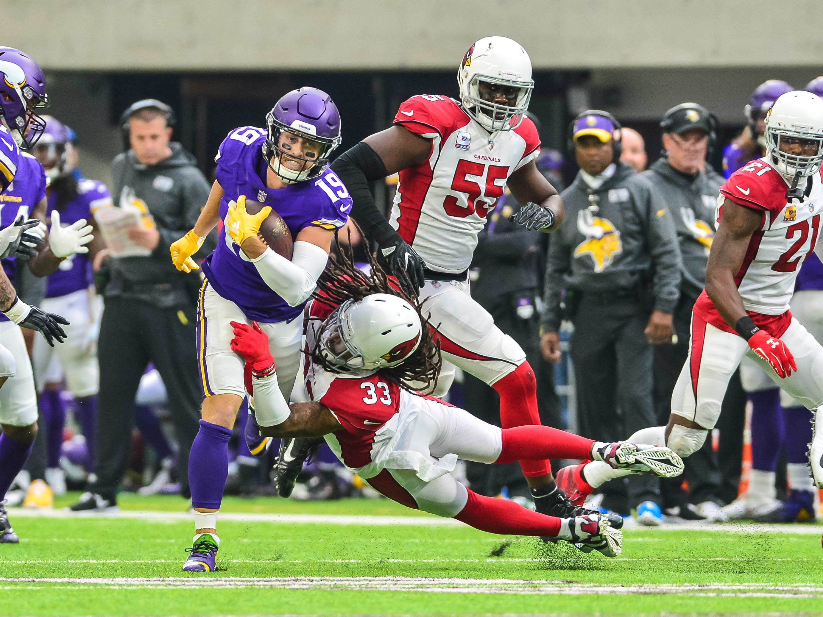 Minnesota Vikings wide receiver Adam Thielen (19) is tackled by Arizona Cardinals defensive back Tre Boston (33) during the first quarter at U.S. Bank Stadium. Thielen recorded 11 receptions for 123 receiving yards and a touchdown on Sunday.