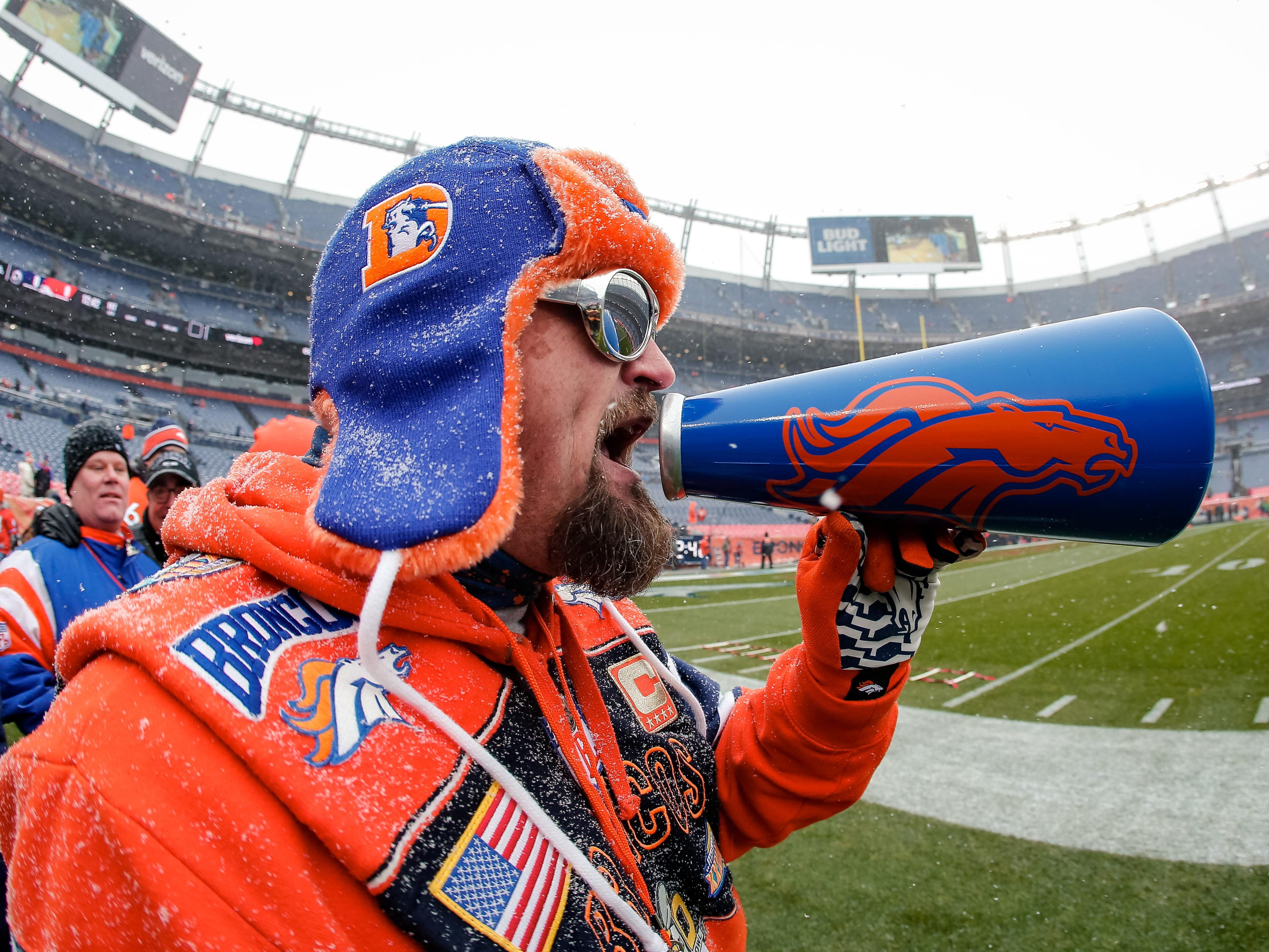 A Denver Broncos fan reacts before a game against the Los Angeles Rams at Broncos Stadium at Mile High.
