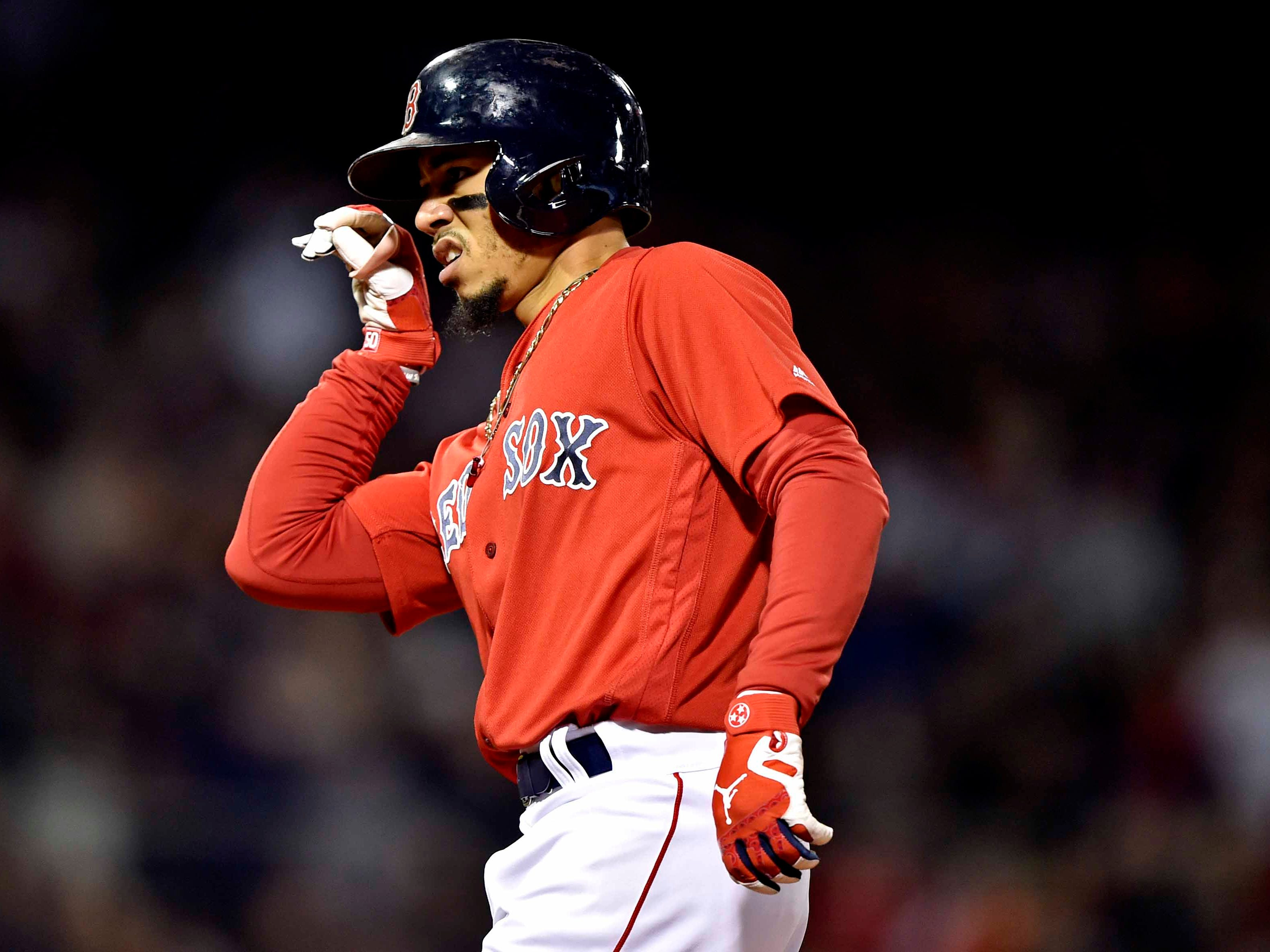 ALCS Game 1: Red Sox right fielder Mookie Betts singles off Justin Verlander in the first inning.