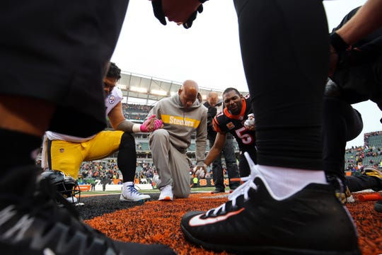 Pittsburgh Steelers Ryan Shazier (middle) joins members of Steelers and Bengals at Paul Brown Stadium, where he suffered a spinal injury last season.