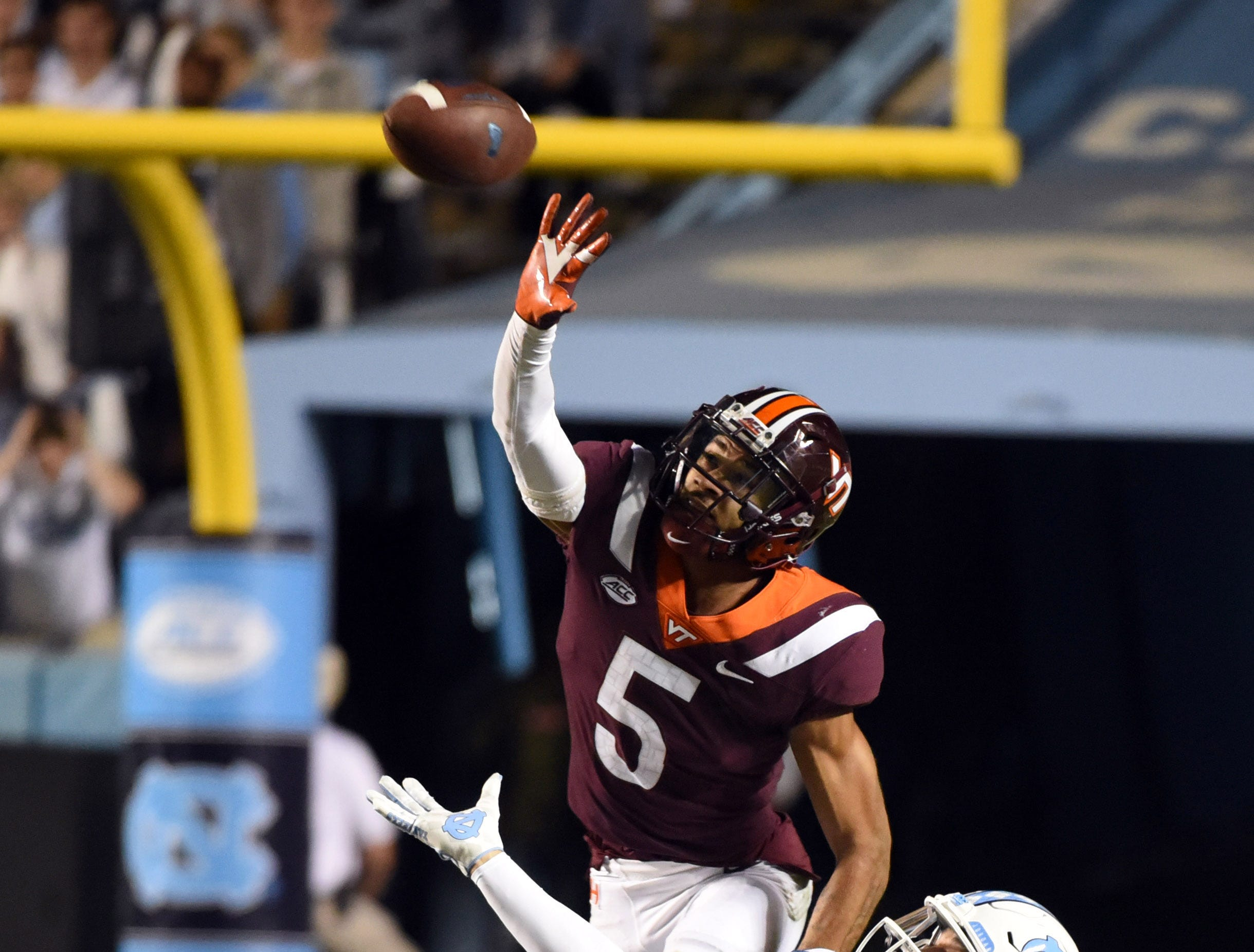 Virginia Tech Hokies defensive back Bryce Watts (5) knocks down a pass in front of North Carolina Tar Heels receiver Beau Corrales (88) during the second half at Kenan Memorial Stadium.