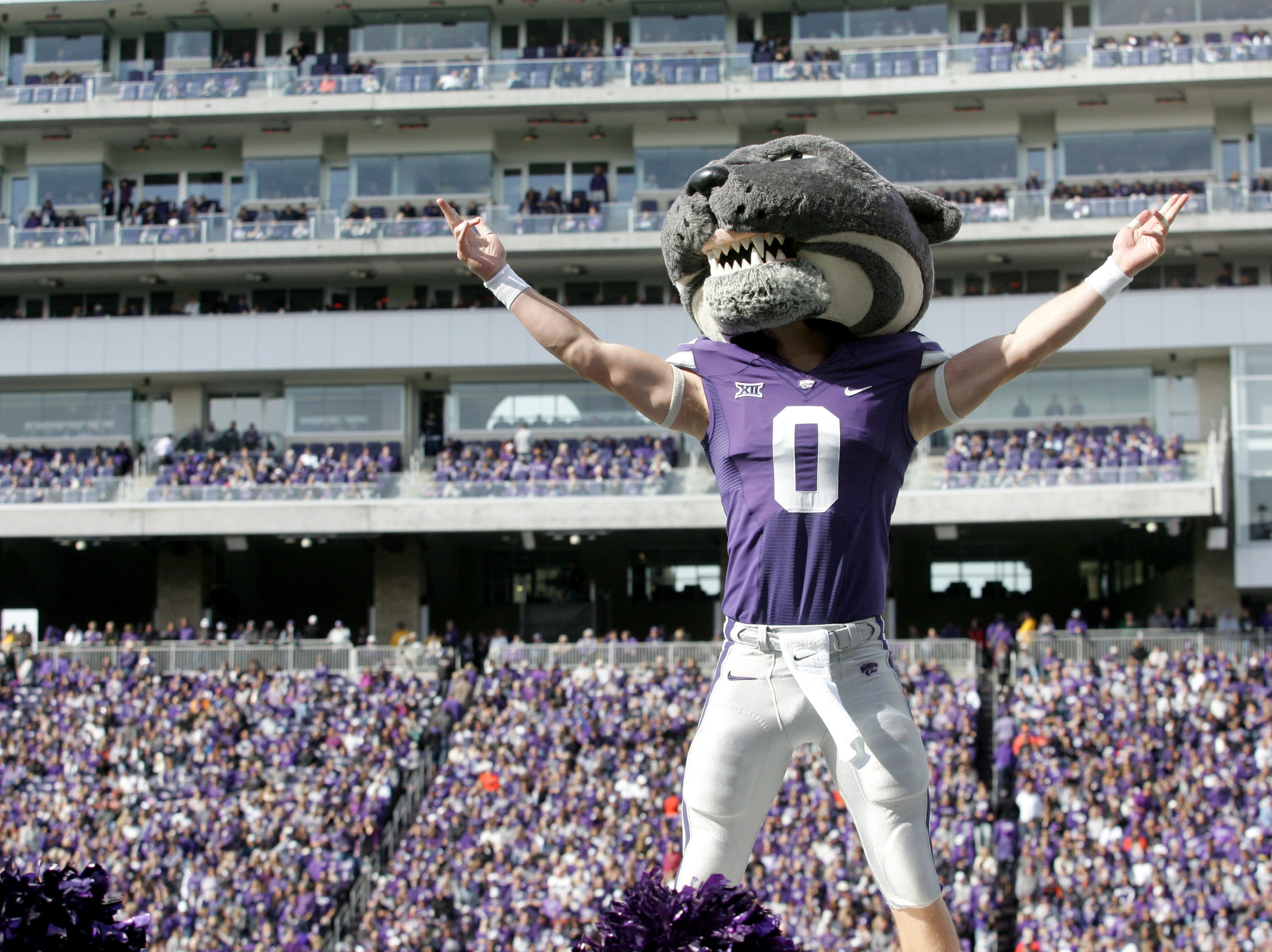Week 7: Kansas State Wildcats mascot Willie the Wildcat celebrates during a game against the Oklahoma State Cowboys at Bill Snyder Family Stadium.