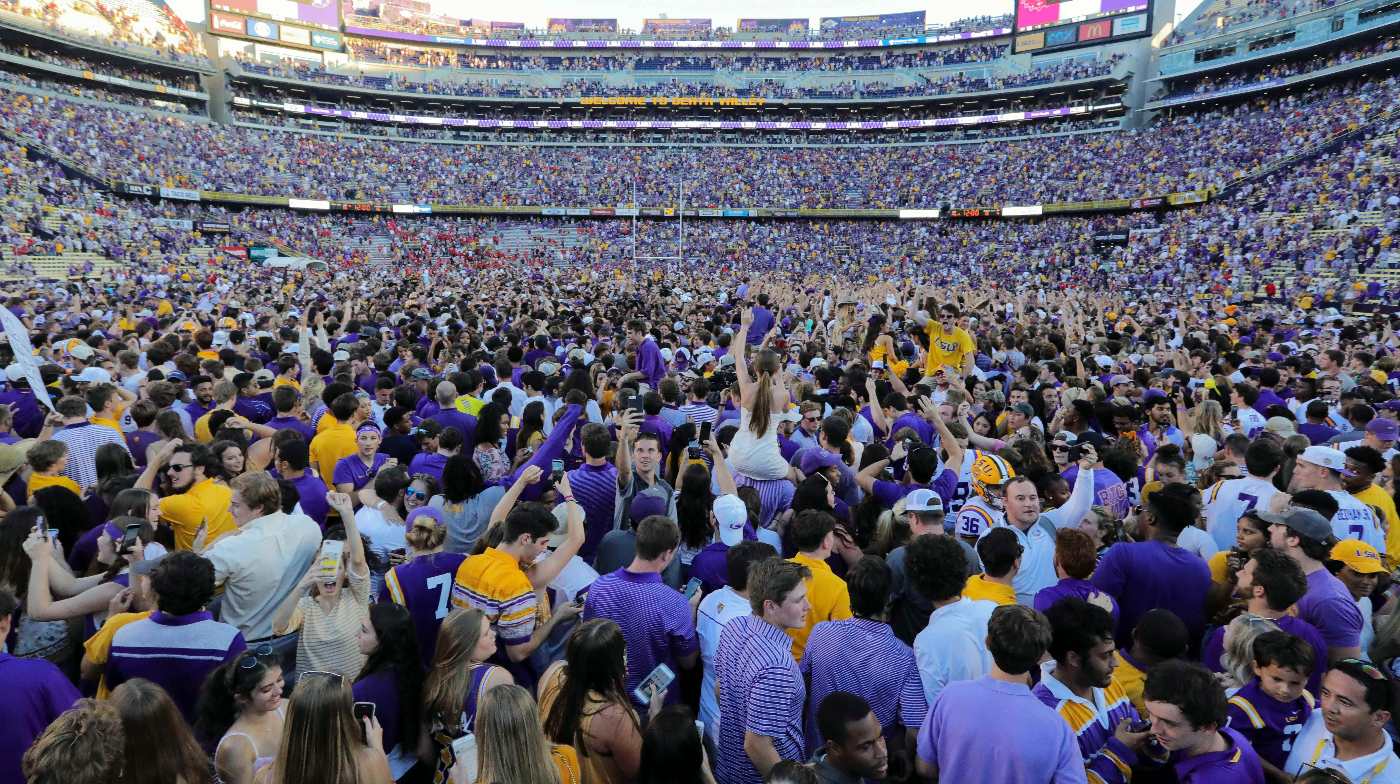 LSU Tigers fans rush the field after the win against the Georgia Bulldogs at Tiger Stadium.
