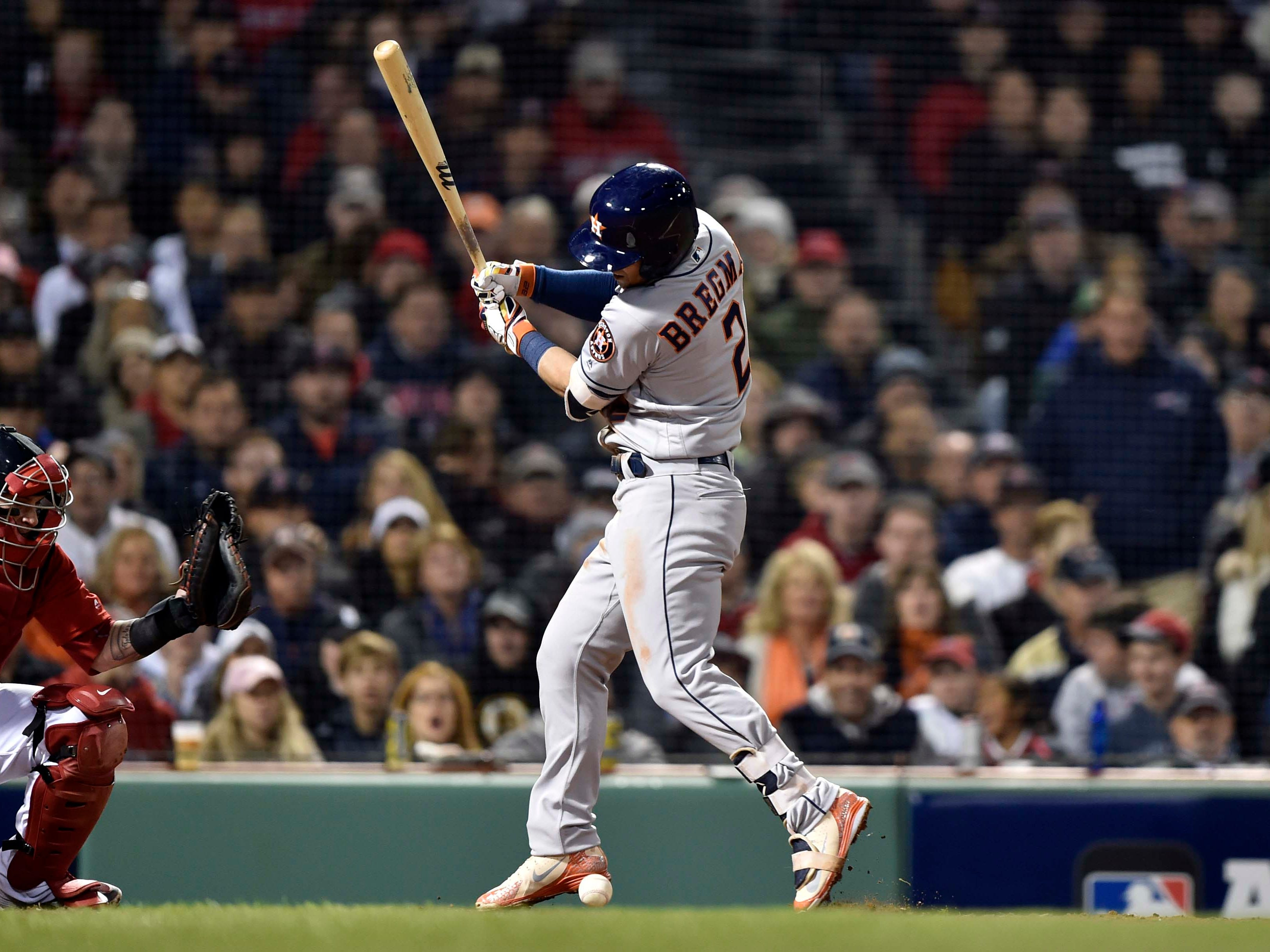 ALCS Game 1: Astros third baseman Alex Bregman is hit by a pitch from Joe Kelly in the fifth inning.