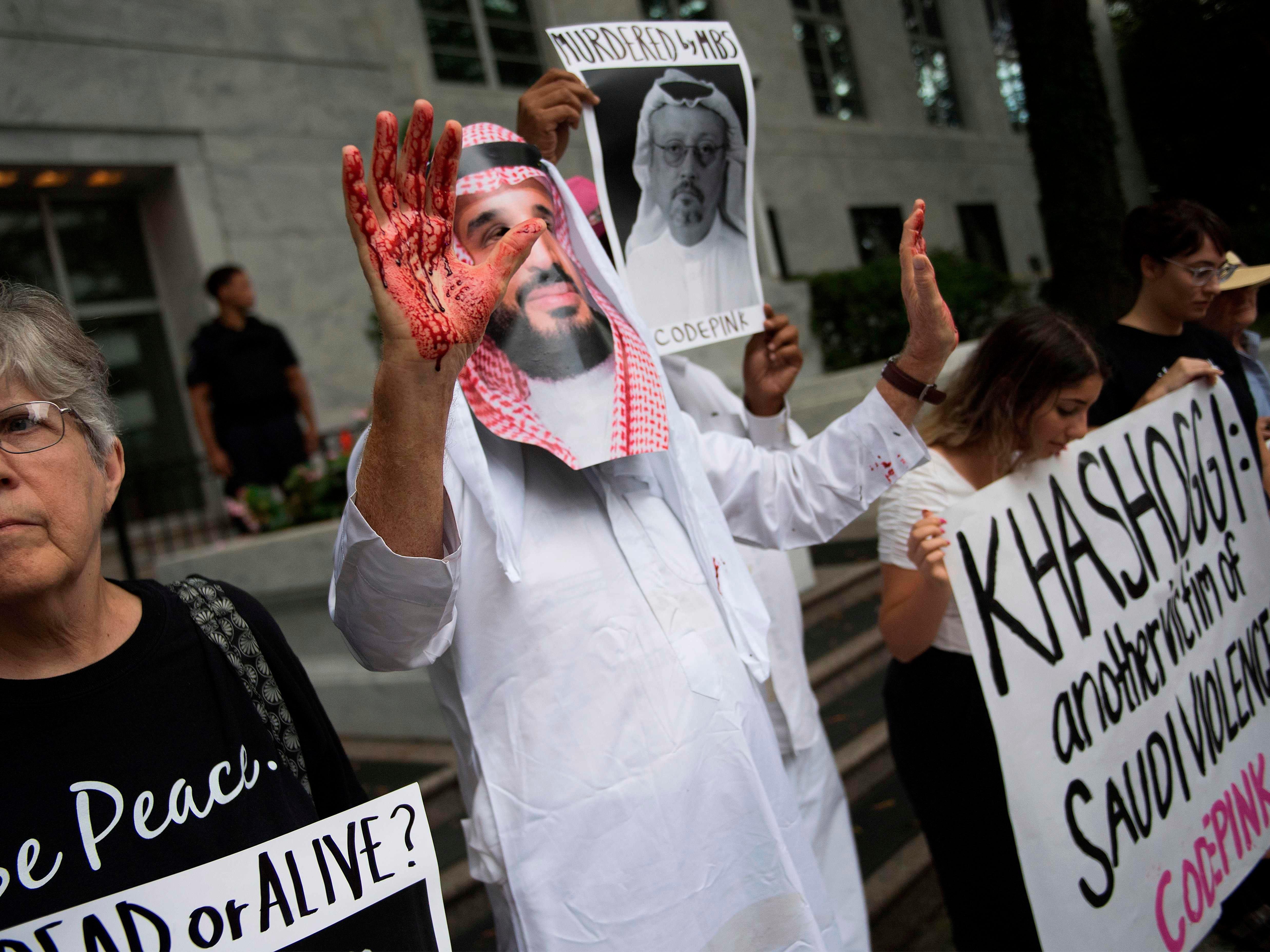 A demonstrator dressed as Saudi Arabian Crown Prince Mohammed bin Salman protests outside the Saudi Embassy in Washington, Oct. 8, 2018.
