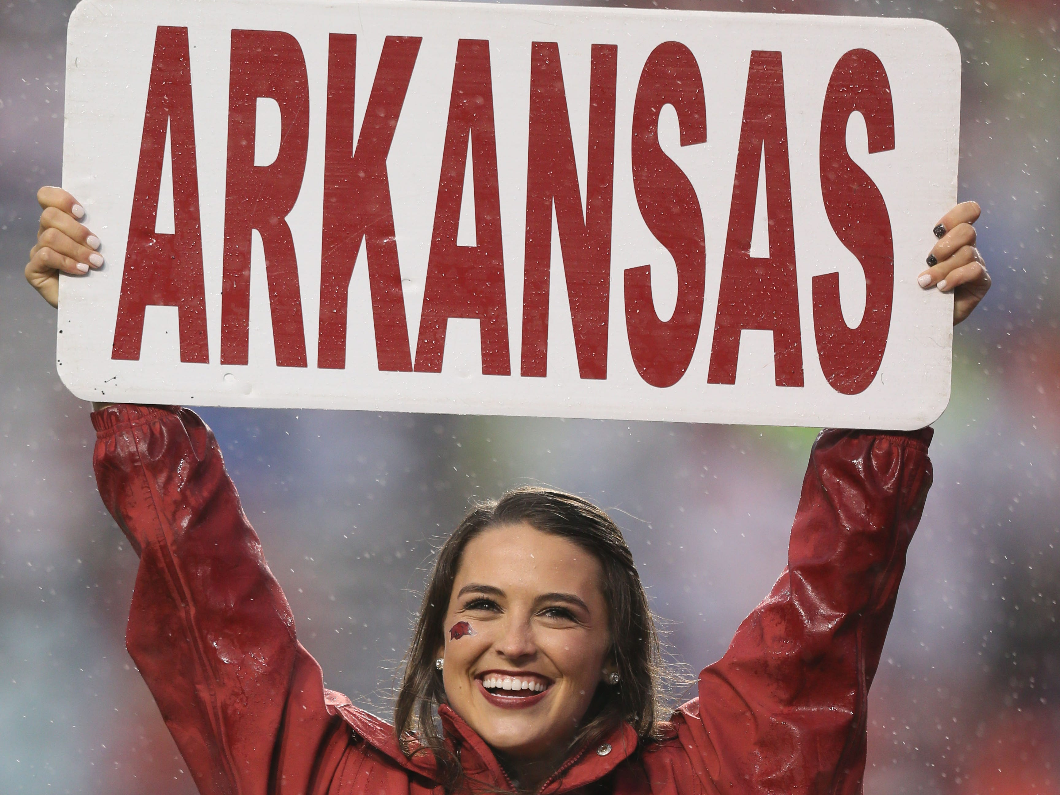 Week 7: An Arkansas Razorbacks cheerleader prior to the game against the Ole Miss Rebels at War Memorial Stadium.