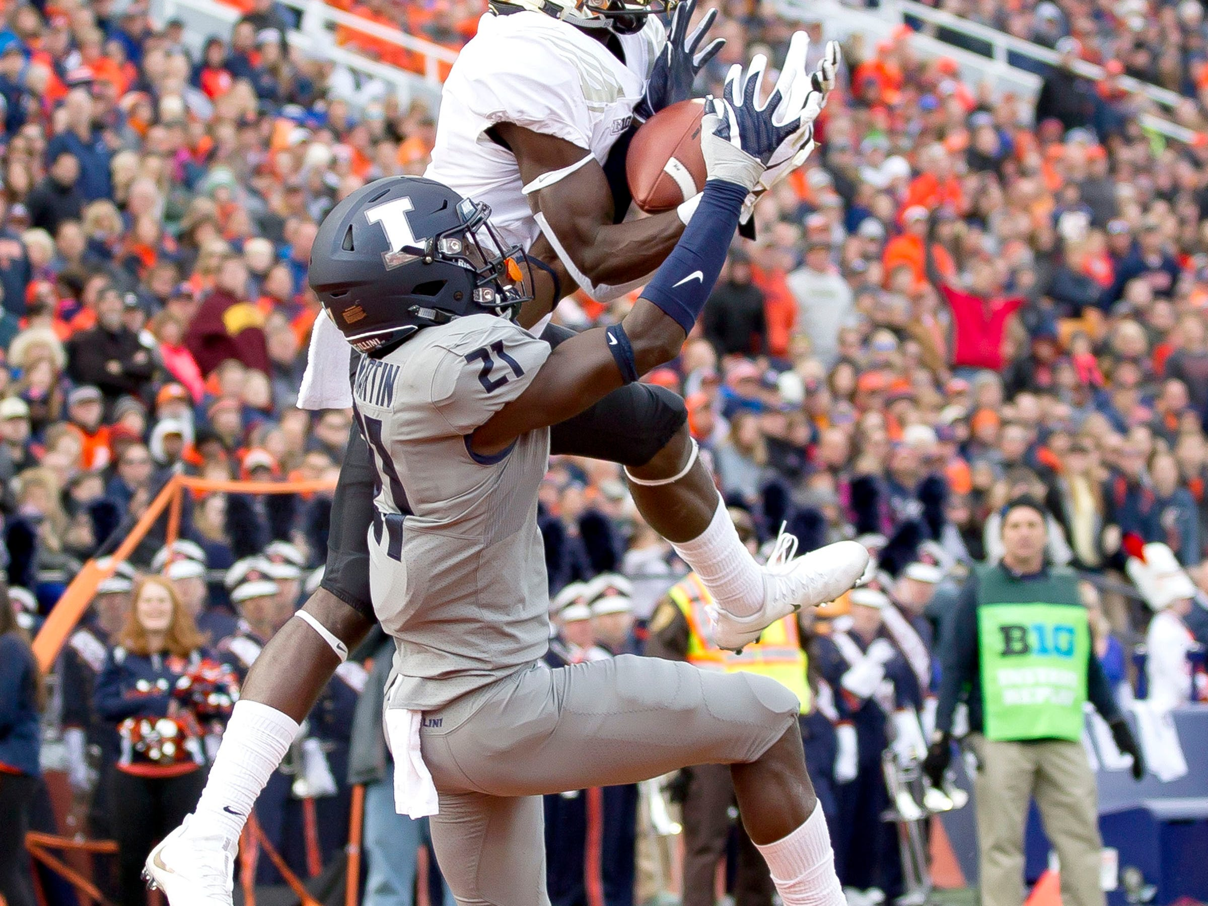 Purdue Boilermakers wide receiver Isaac Zico (7) catches a toudhdown pass while defended by Illinois Fighting Illini defensive back Jartavius Martin (21) during the second quarter at Memorial Stadium.