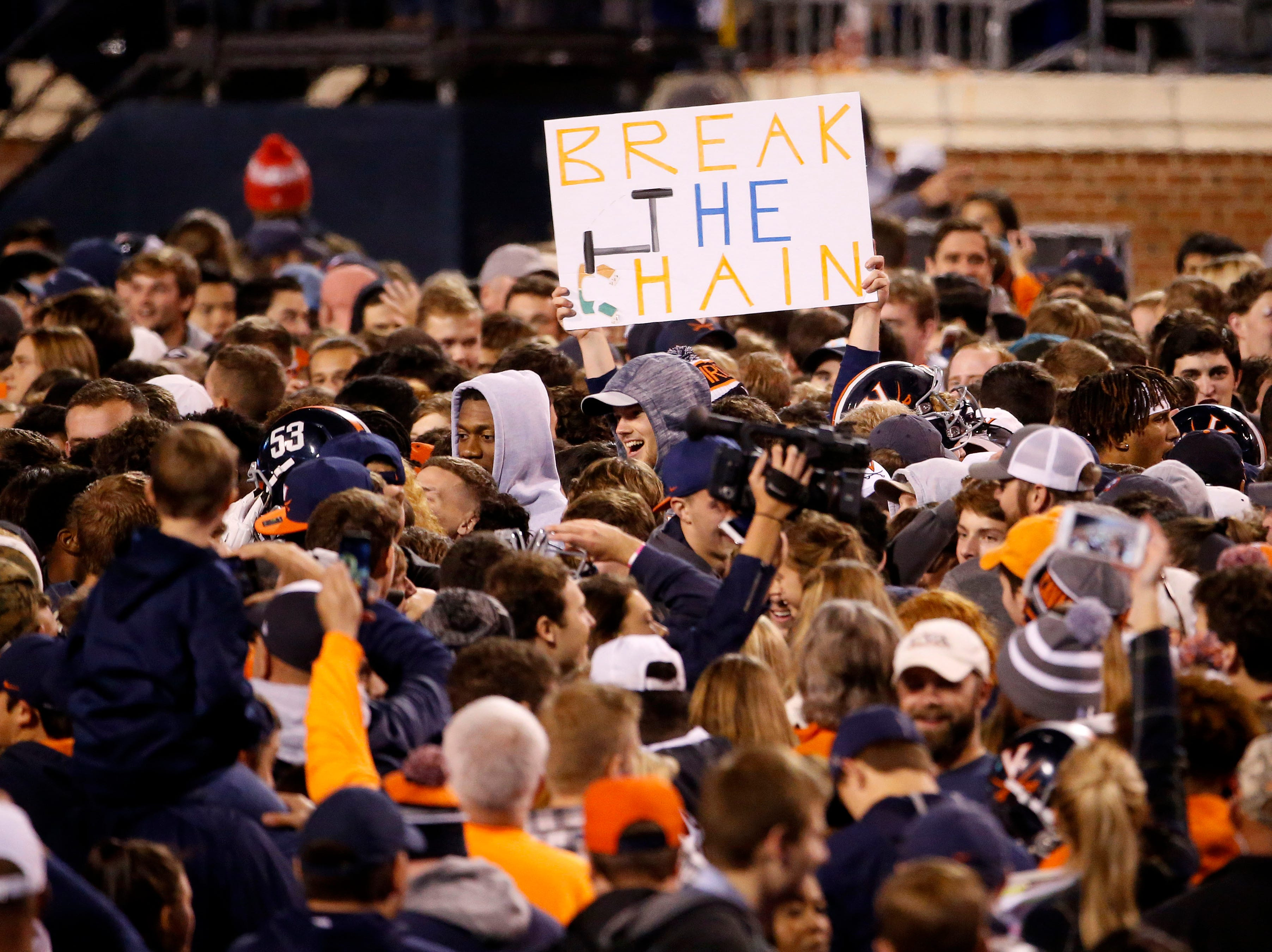 Week 7: Virginia Cavaliers fans storm the field after the win over the Miami Hurricanes at Scott Stadium.