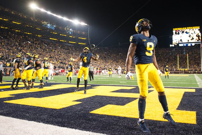 Michigan Wolverines wide receiver Donovan Peoples-Jones (9) celebrates during the fourth quarter against the Wisconsin Badgers at Michigan Stadium.