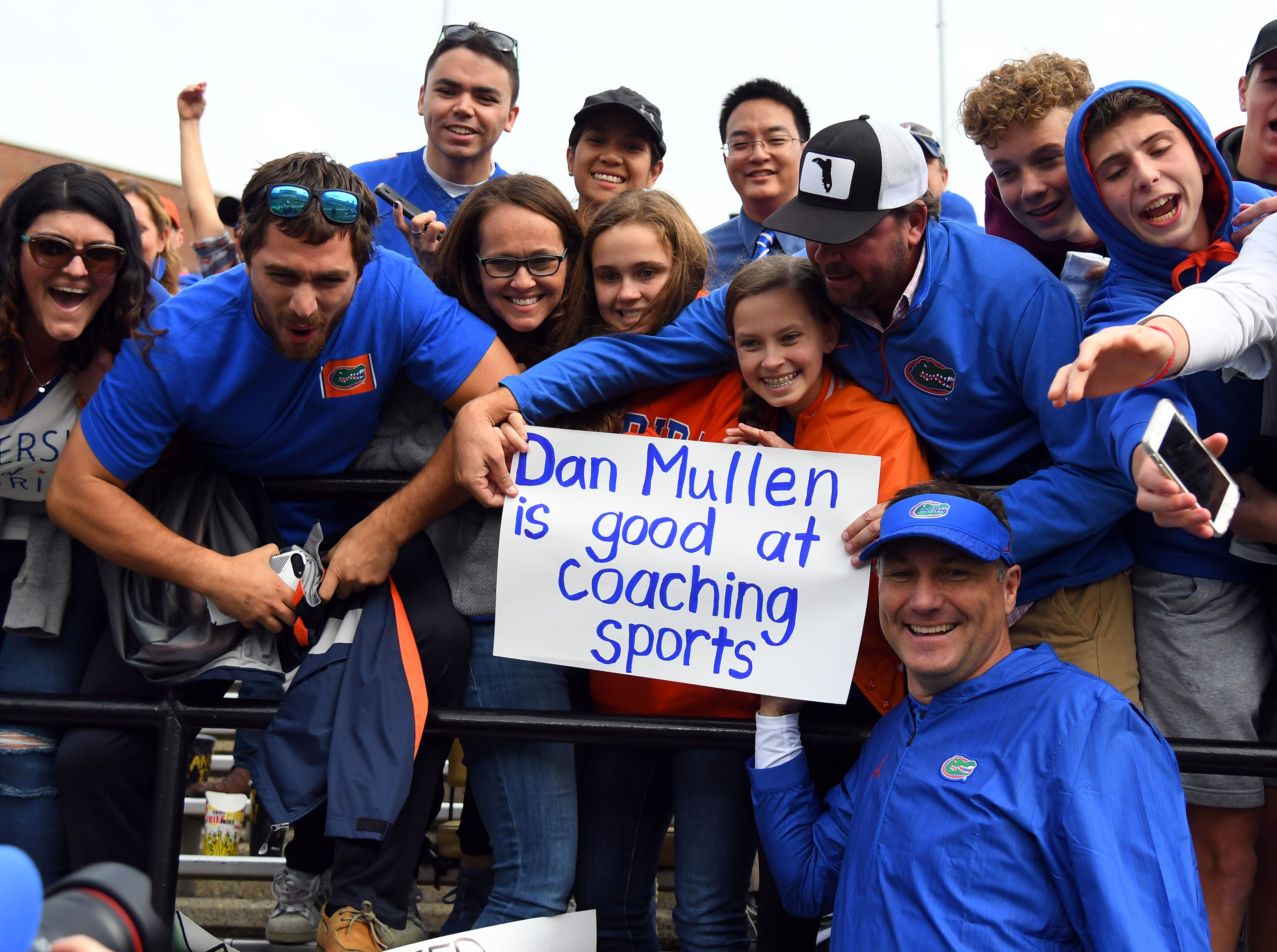 Week 7: Florida Gators head coach Dan Mullen poses for a photo with fans after a win against the Vanderbilt Commodores at Vanderbilt Stadium.