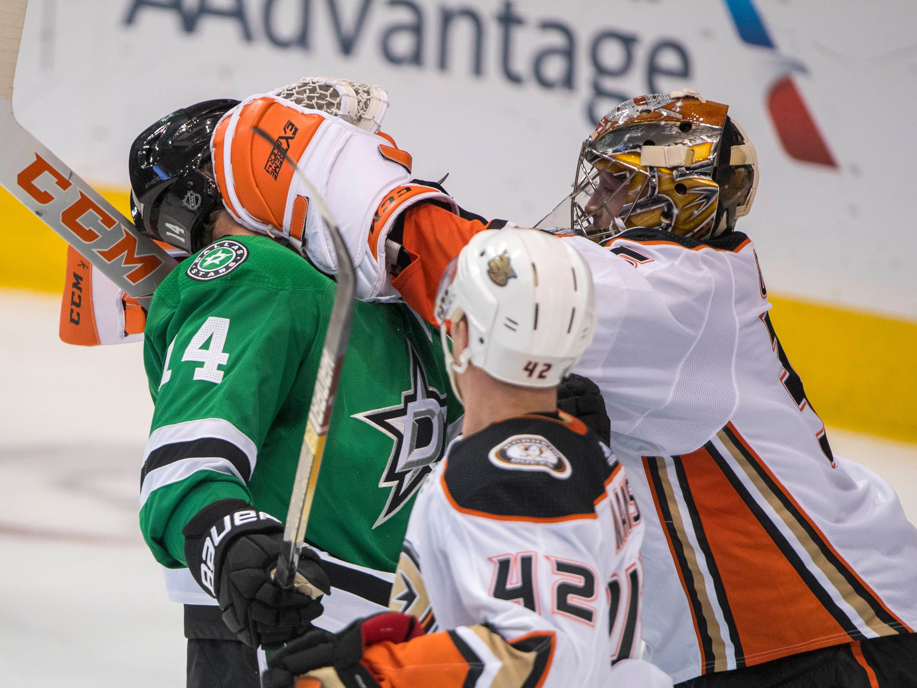 Oct 13: Ducks goaltender John Gibson (36) fights with Stars left wing Jamie Benn (14)