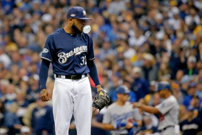 Brewers reliever Jeremy Jeffress reacts after walking in a run during the seventh inning against the Dodgers in NLCS Game 2.