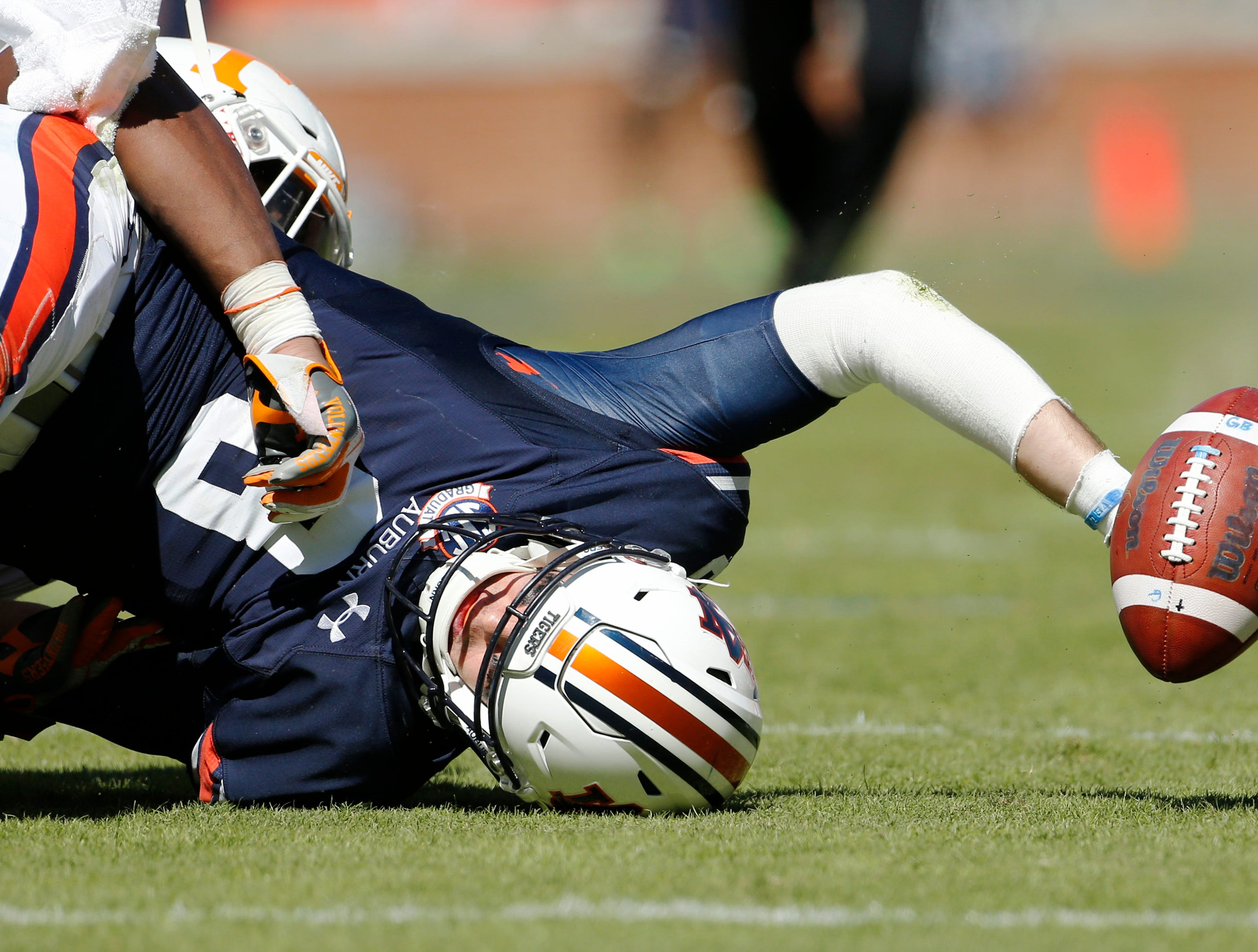 Auburn Tigers quarterback Jarrett Stidham (8) fumbles fduring the third quarter against the Tennessee Volunteers at Jordan-Hare Stadium.