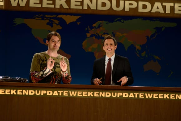 "Stefon (Bill Hader) and Seth Meyers on the ""Weekend Update"" desk in 2012."