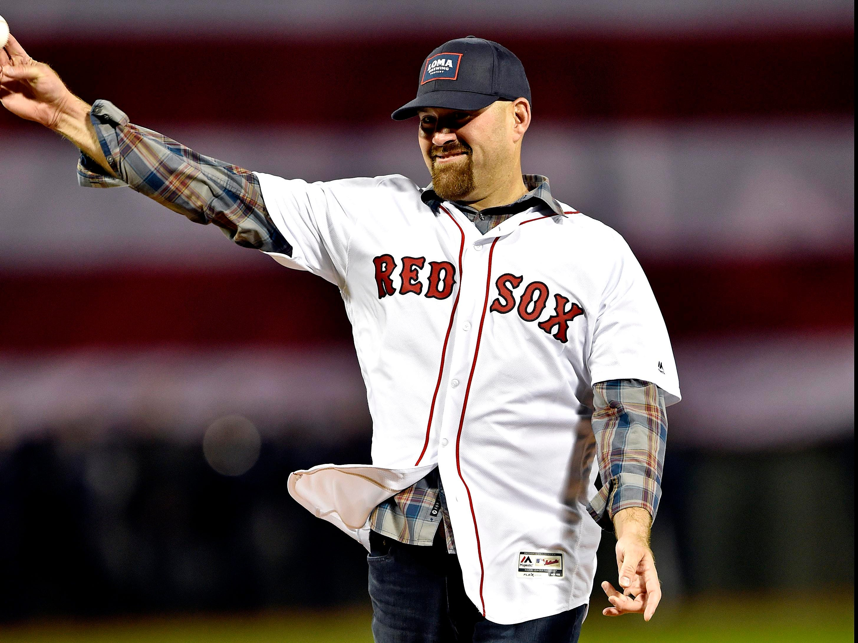 ALCS Game 1: Former Red Sox Kevin Youkilis throws the first pitch.