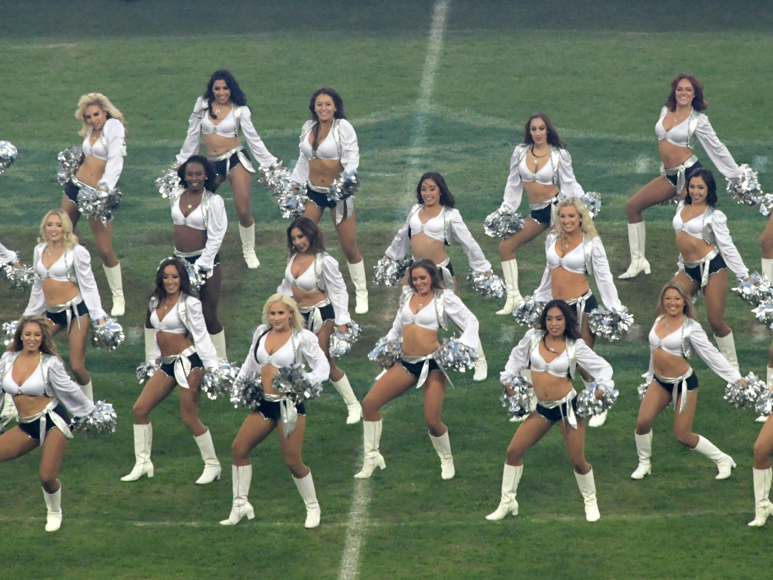 Oakland Raiders raiderette cheerleaders perform during an NFL International Series game against the Seattle Seahawks at Wembley Stadium in London.