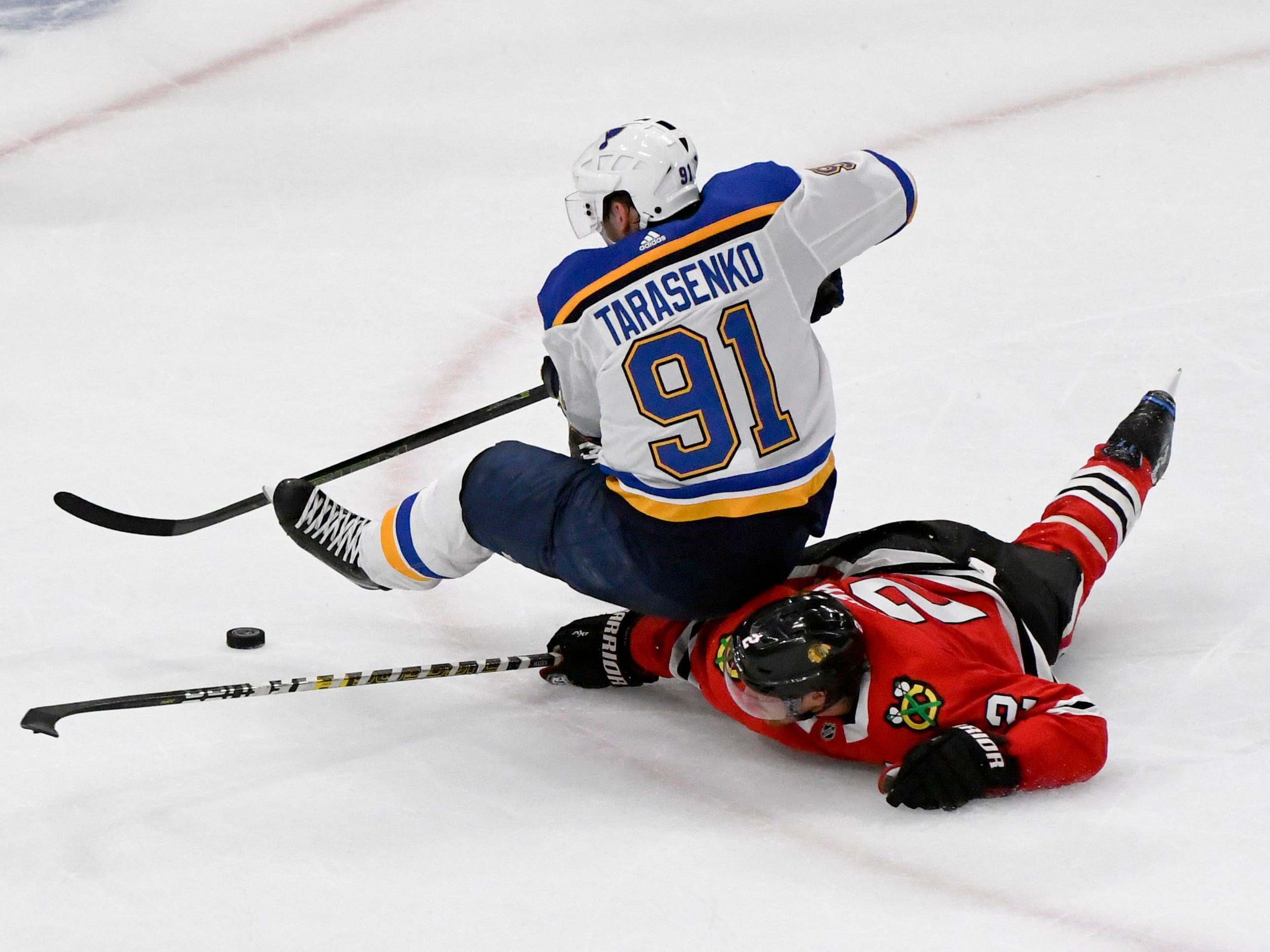 Oct. 13: St. Louis Blues right wing Vladimir Tarasenko (91) and Chicago Blackhawks defenseman Duncan Keith (2) fight for the puck during the third period at the United Center in Chicago.