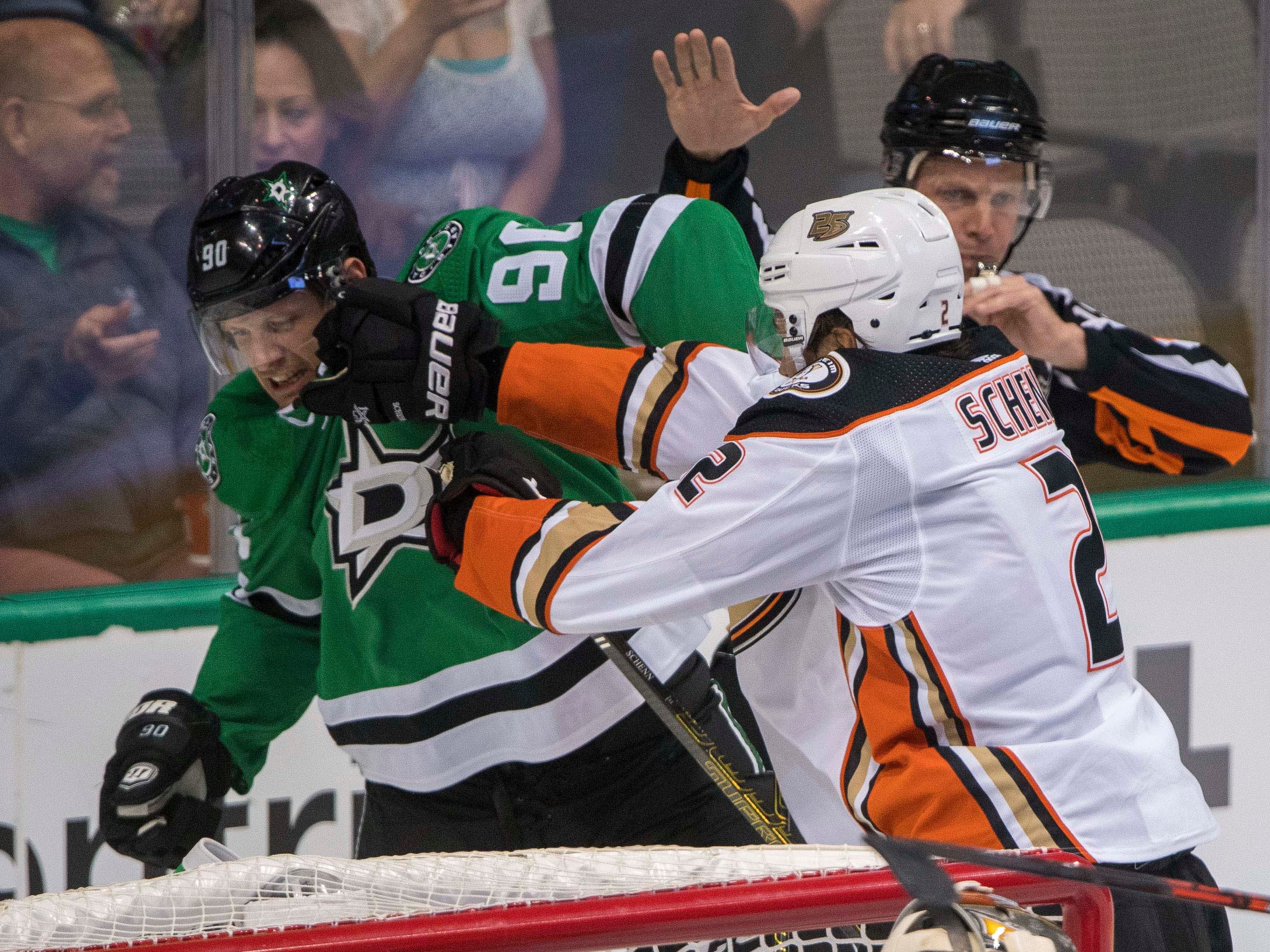 Oct 13: Ducks defenseman Luke Schenn (2) fights with Stars center Jason Spezza (90)