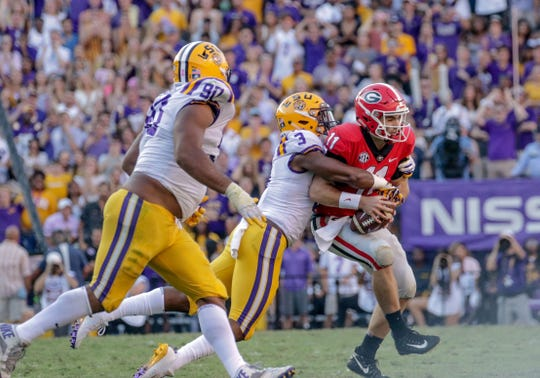 LSU safety JaCoby Stevens sacks Georgia quarterback Jake Fromm during the second half at Tiger Stadium.